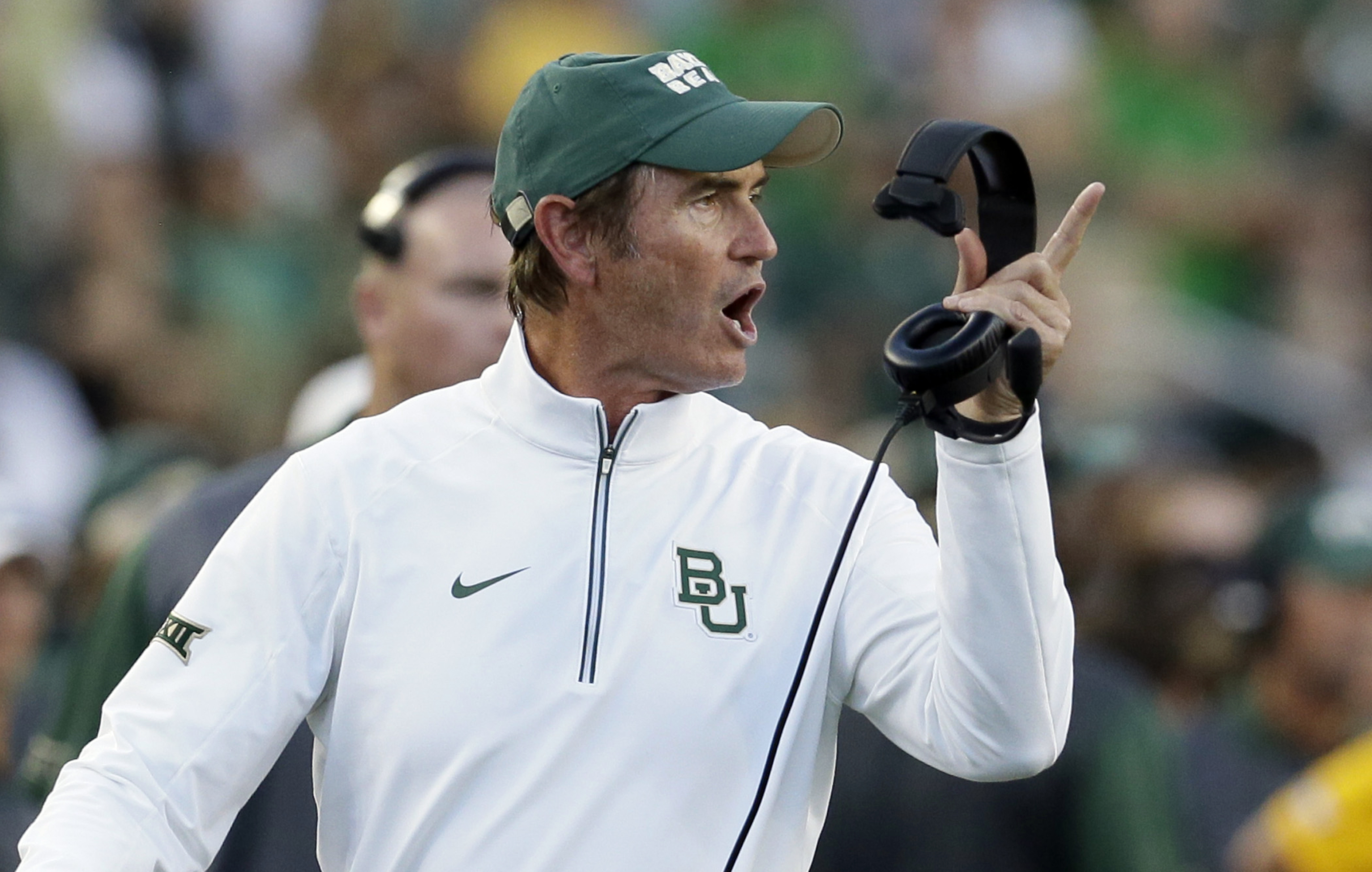FILE - In this Sept. 12, 2015, file photo, Baylor coach Art Briles yells from the sideline during the first half of an NCAA college football game against Lamar in Waco, Texas. Things may be supersized in Texas, but for North Carolina's Larry Fedora and Ba