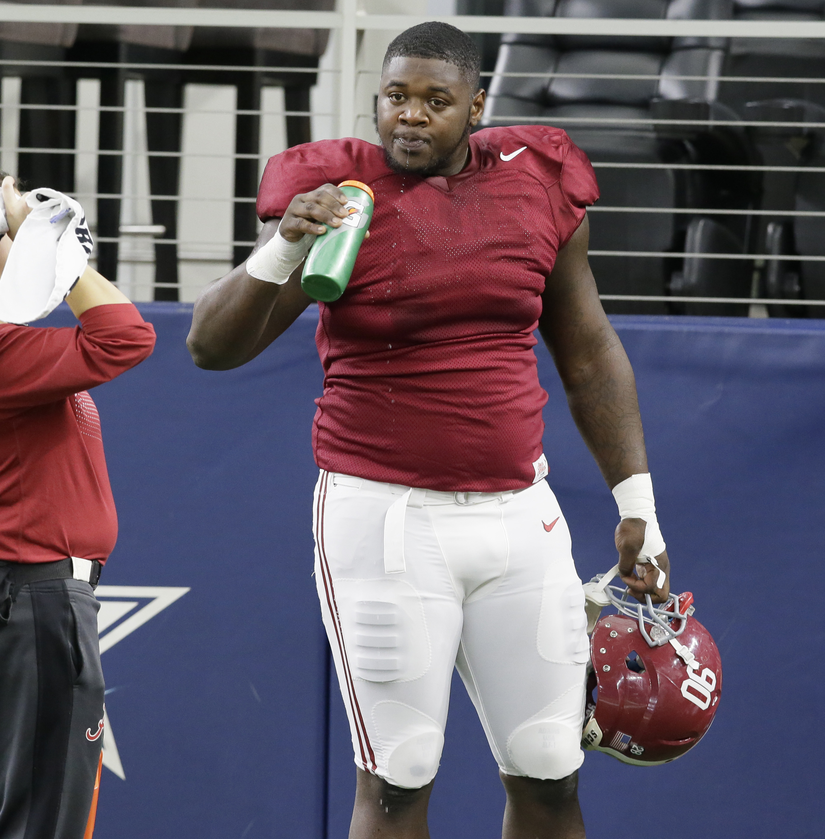 Alabama defensive lineman Jarran Reed (90) takes a break  during team practice for the NCAA Cotton Bowl college football game against  against the Michigan State Monday, Dec. 28, 2015, in Arlington, Texas. (AP Photo/LM Otero)