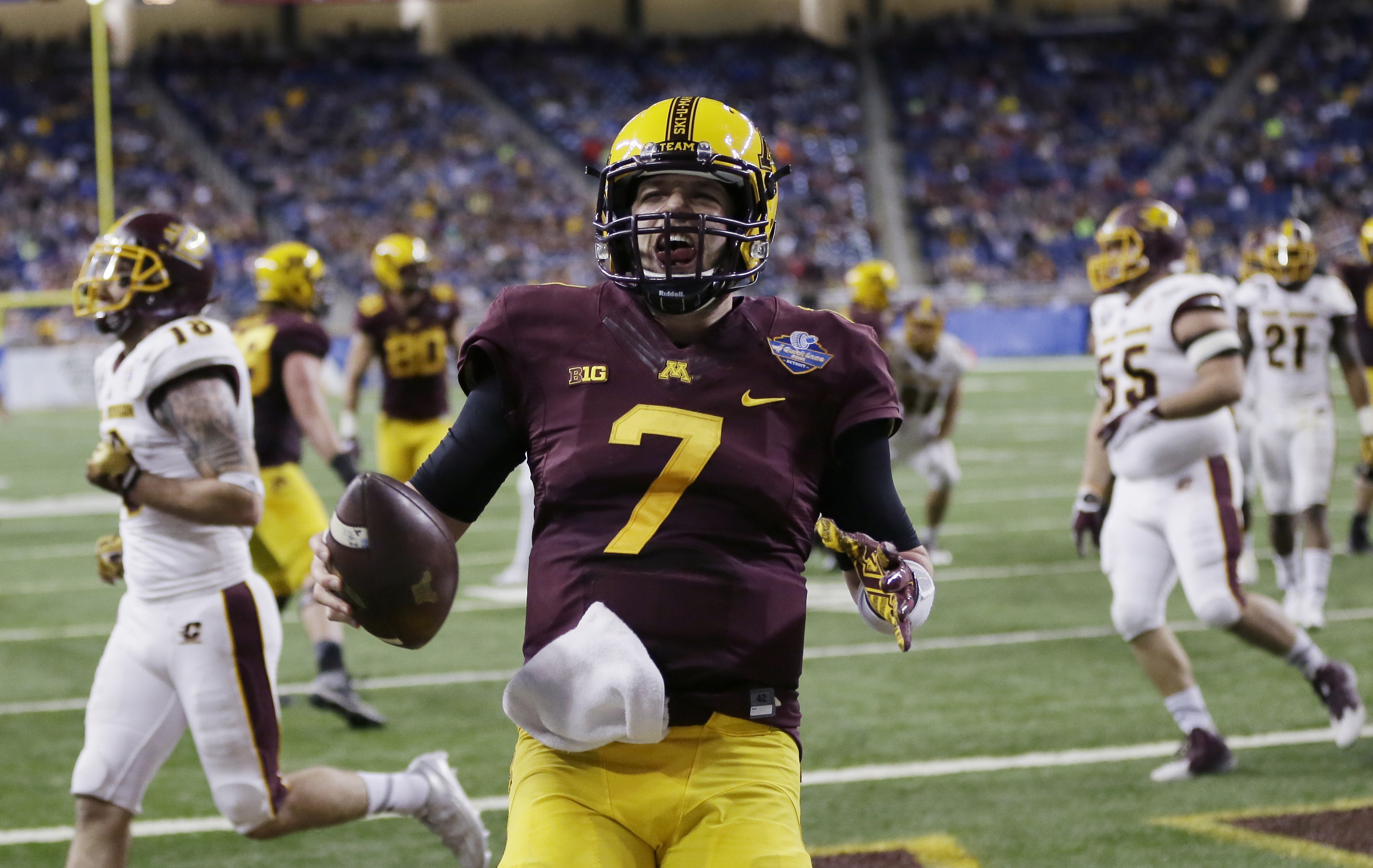 Minnesota quarterback Mitch Leidner reacts after outrunning the Central Michigan defense for the go-ahead touchdown during the second half of the Quick Lane Bowl NCAA college football game, Monday, Dec. 28, 2015, in Detroit. Minnesota defeated Central Mic