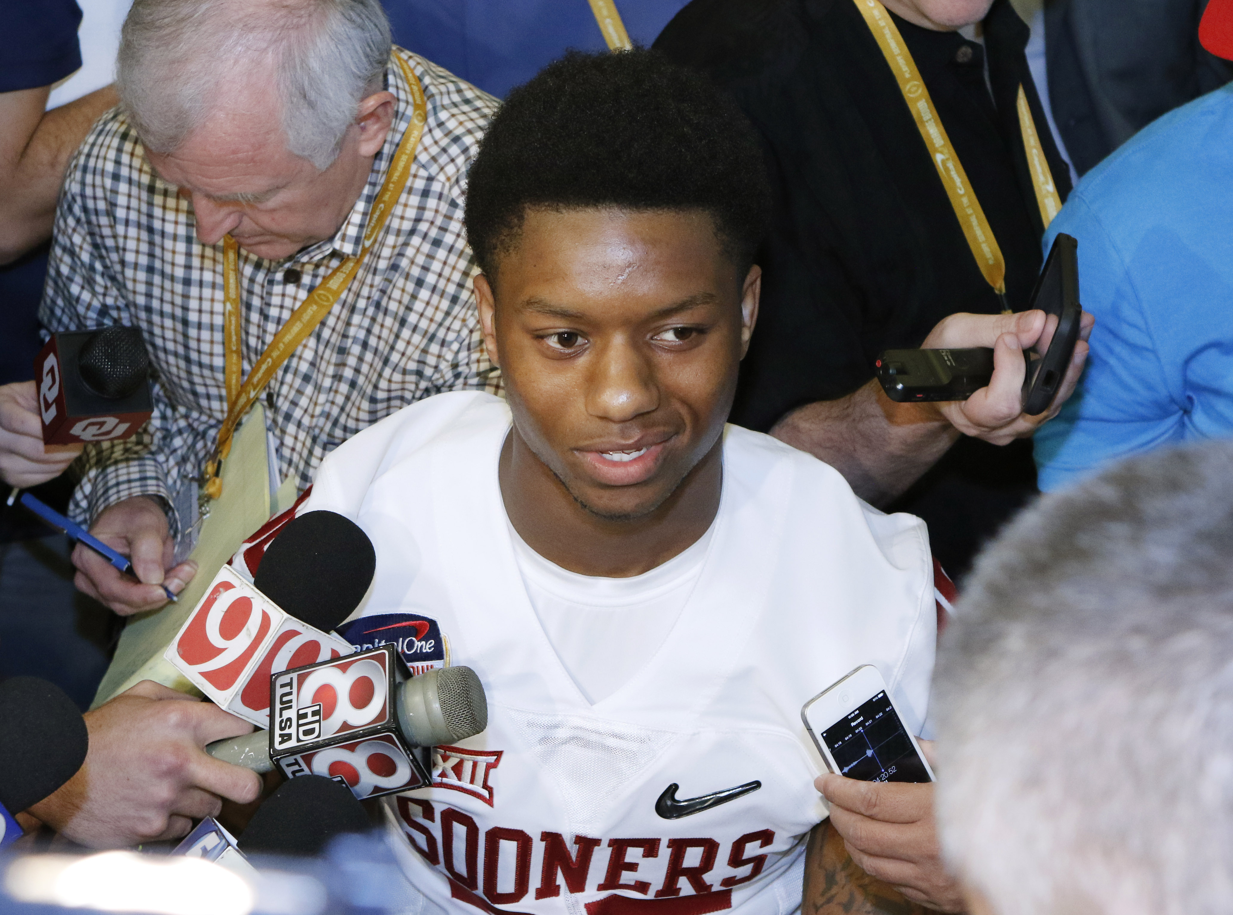 Oklahoma running back Joe Mixon speaks with reporters during the media day for the Orange Bowl at Sun Life Stadium Tuesday, Dec. 29, 2015, in Miami Gardens Fla. Oklahoma is scheduled to play Clemson in the Orange Bowl NCAA college football game on New Yea