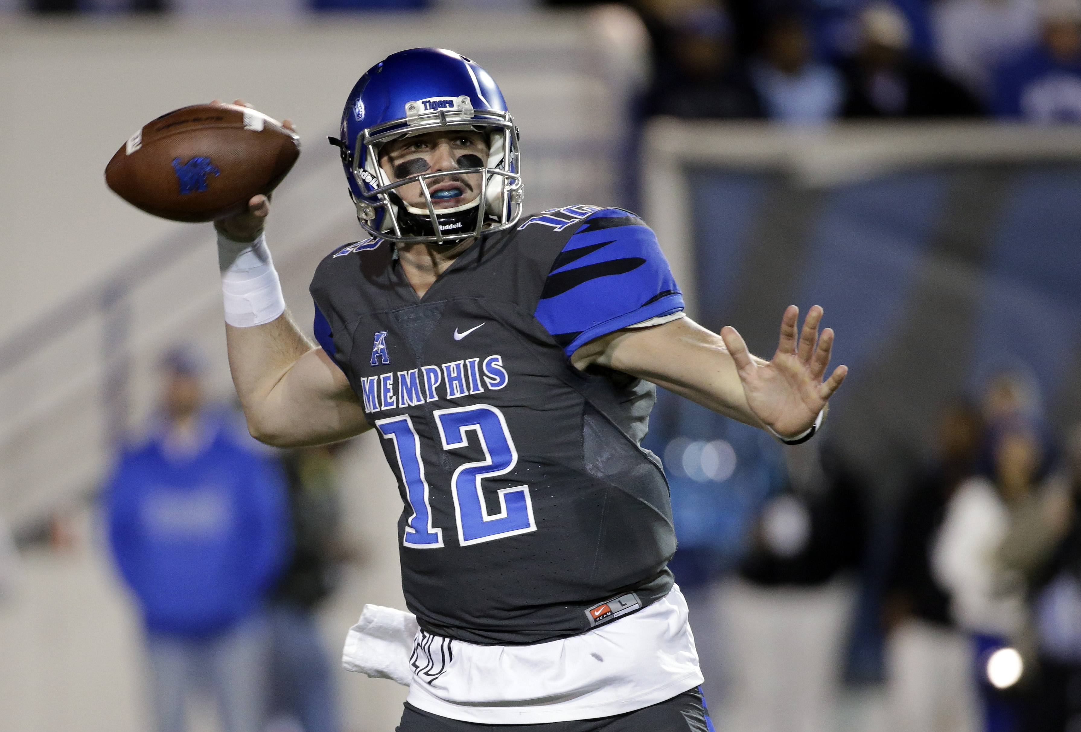 FILE - In this Nov. 7, 2015, file photo, Memphis quarterback Paxton Lynch (12) passes against Navy in the first half of an NCAA college football game in Memphis, Tenn. Memphis (9-3) and Lynch are aiming for another win over a Southeastern Conference team