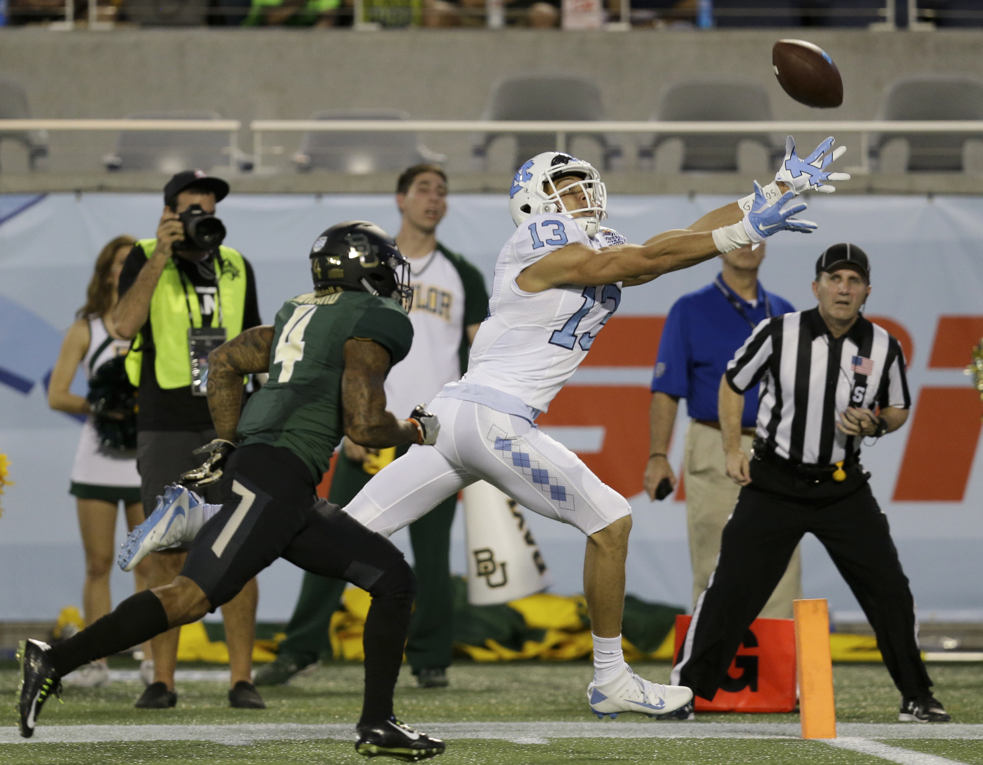 North Carolina wide receiver Mack Hollins (13) reaches but can't make a catch on an overthrown pass as he is guarded by Baylor cornerback Xavien Howard, left, during the first half of the Russell Athletic Bowl NCAA college football game, Tuesday, Dec. 29,