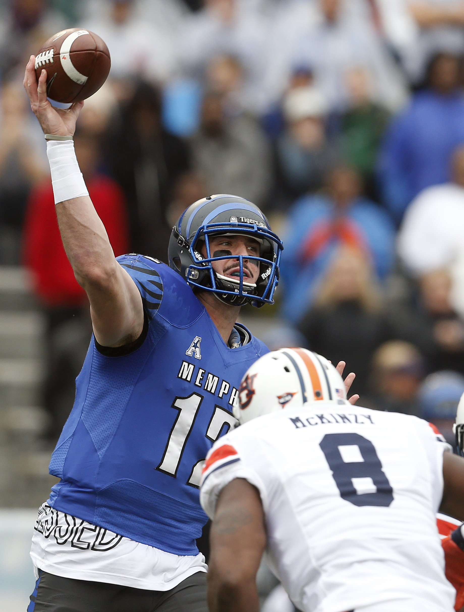 Memphis quarterback Paxton Lynch (12) throws a pass as Auburn linebacker Cassanova McKinzy (8) pressures him during the first half of the Birmingham Bowl NCAA college football game, Wednesday, Dec. 30, 2015, in Birmingham, Ala. (AP Photo/Butch Dill)