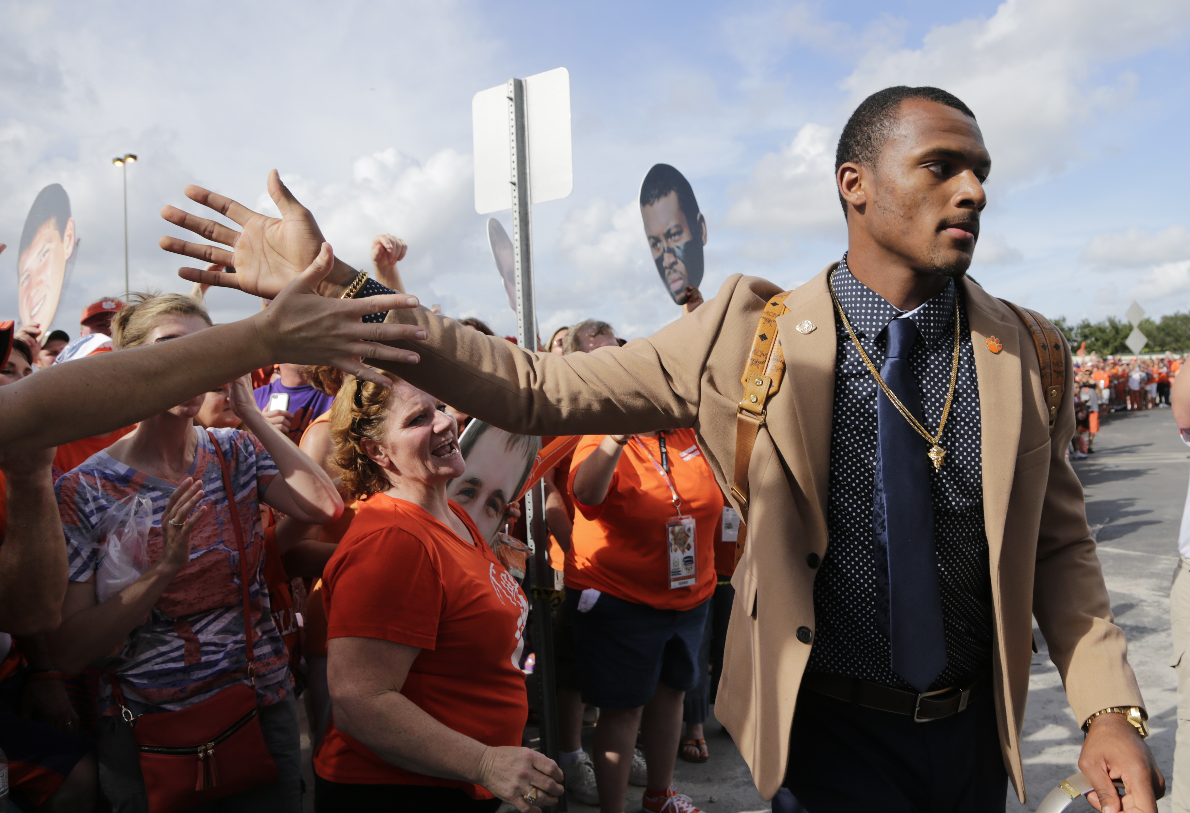 Clemson quarterback Deshaun Watson greets a fan as he arrives for the Orange Bowl NCAA college football semifinal playoff game against Oklahoma, Thursday, Dec. 31, 2015, in Miami Gardens, Fla. (AP Photo/Lynne Sladky)