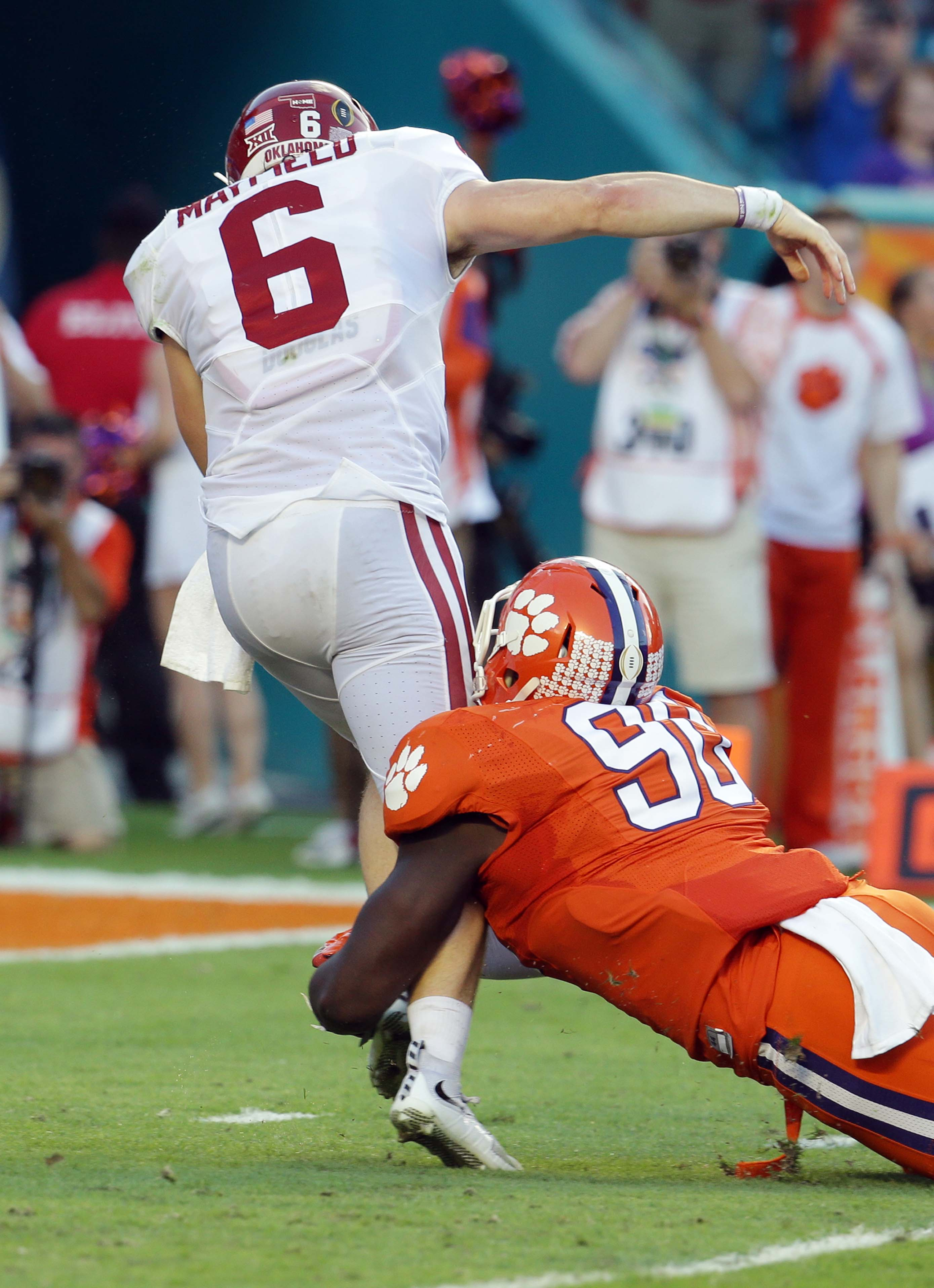 Oklahoma quarterback Baker Mayfield (6) is sacked by Clemson defensive end Shaq Lawson (90) during the first half of the Orange Bowl NCAA college football semifinal playoff game, Thursday, Dec. 31, 2015, in Miami Gardens, Fla. (AP Photo/Lynne Sladky)
