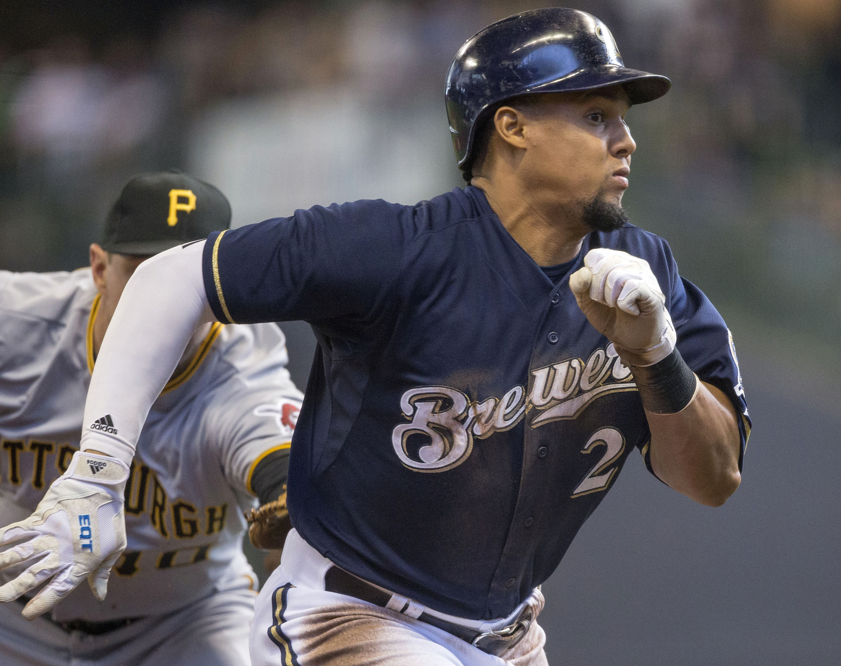 Milwaukee Brewers' Carlos Gomez, right, is caught stealing third by Pittsburgh Pirates' Jordy Mercer during the fifth inning of a baseball game Sunday, April 12, 2015, in Milwaukee. (AP Photo/Tom Lynn)