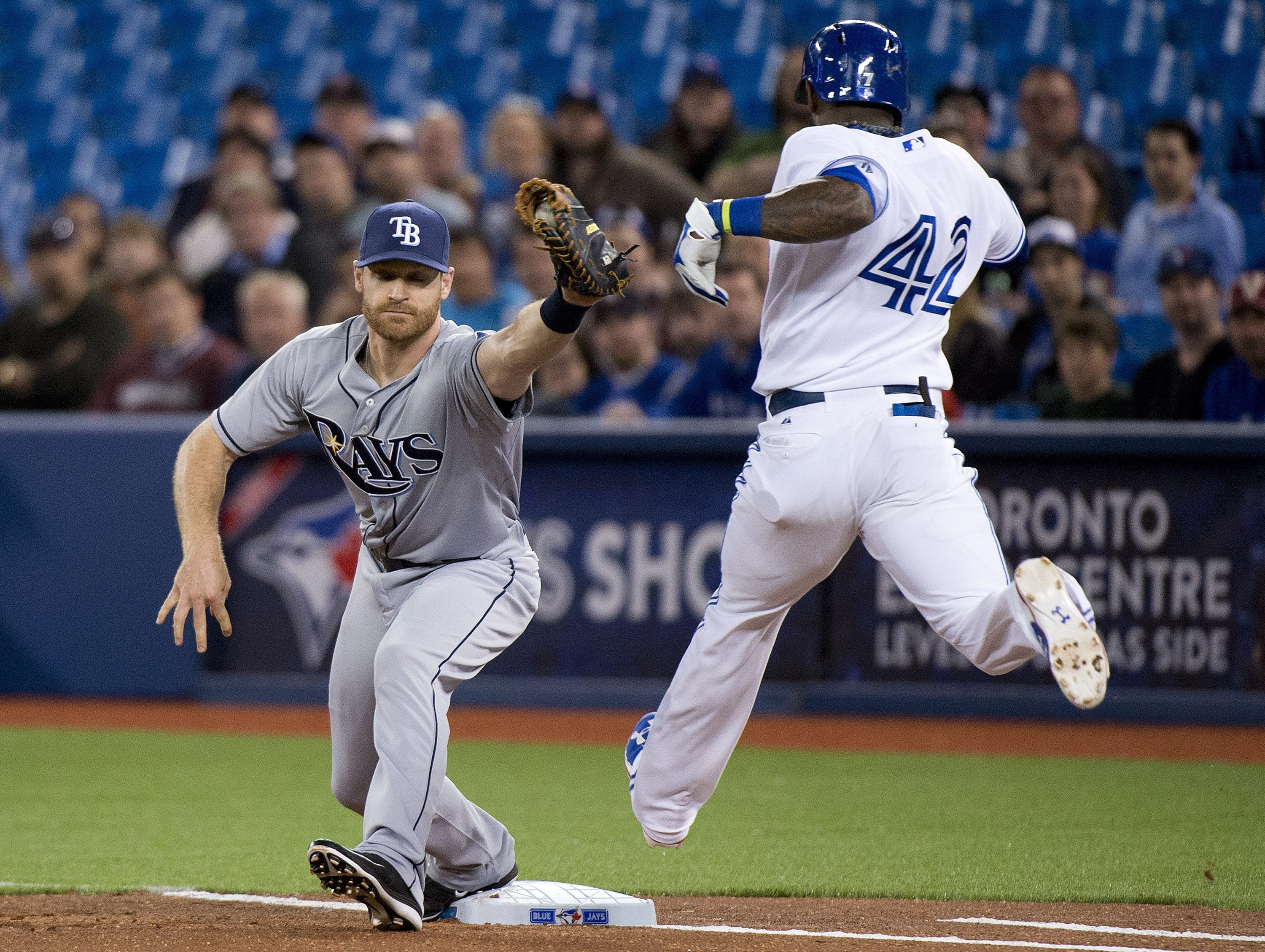 Toronto Blue Jays shortstop Jose Reyes is thrown out as Tampa Bay Rays first baseman Logan Forsythe, left, makes the catch during first inning of a baseball game, Wednesday, April 15, 2015 in Toronto. (Nathan Denette/The Canadian Press via AP)  MANDATORY