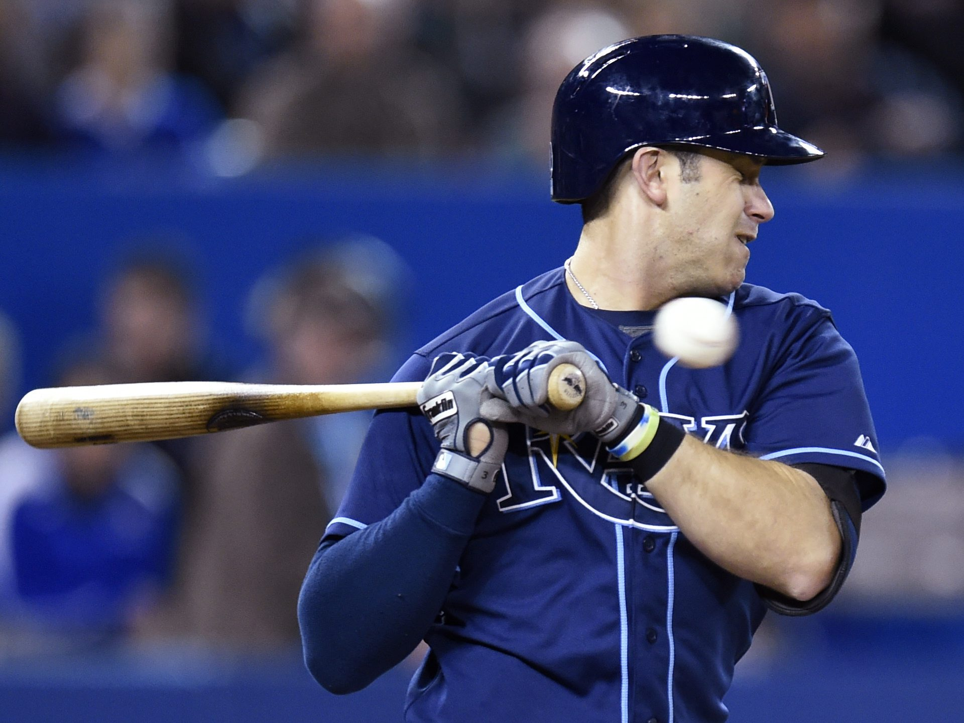 Tampa Bay Rays' Evan Longoria moves out of the way of an inside pitch from Toronto Blue Jays' Aaron Sanchez during the fourth inning of a baseball game, Thursday, April 16, 2015 in Toronto. (Frank Gunn/The Canadian Press via AP)  MANDATORY CREDIT
