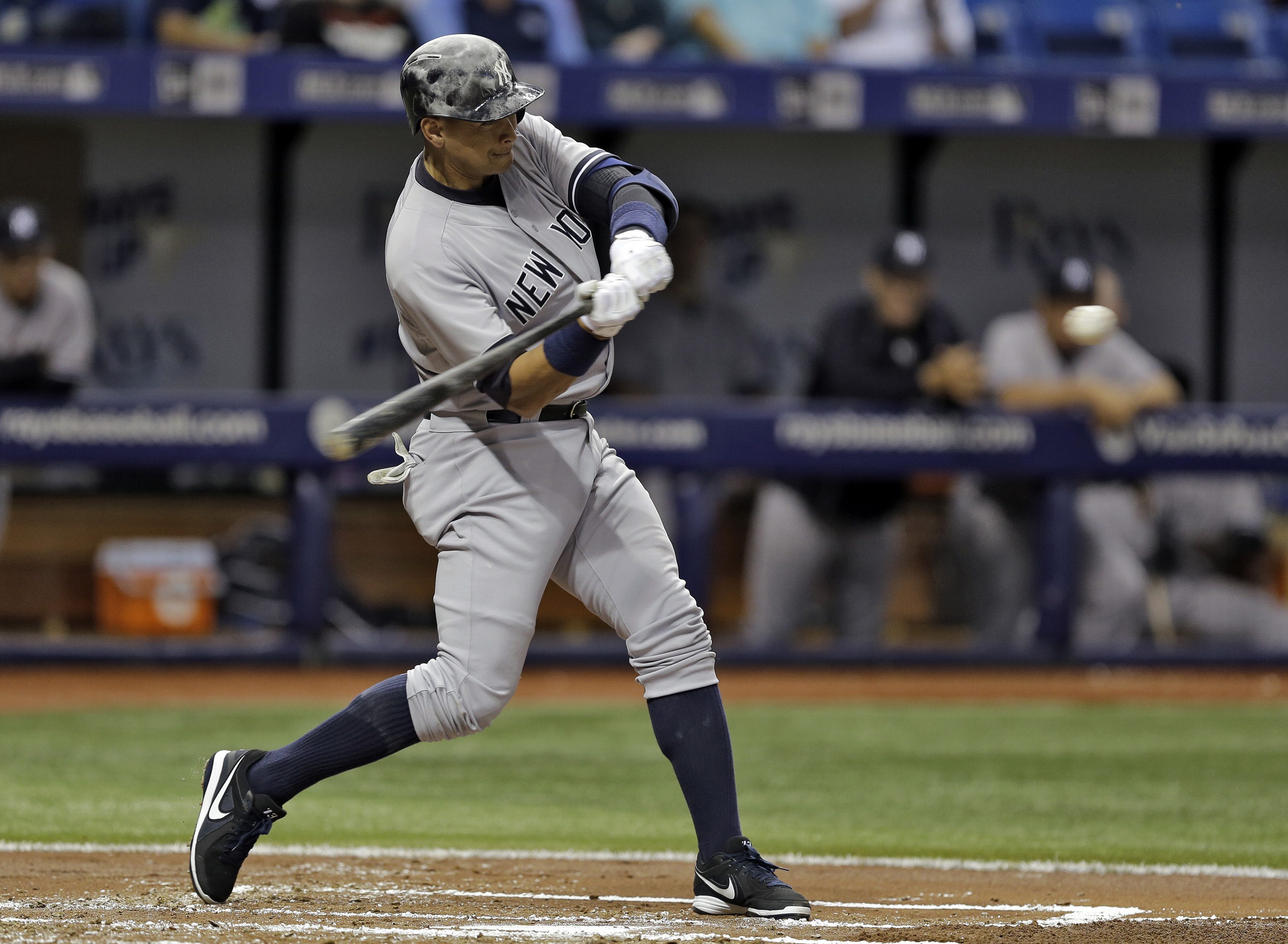 New York Yankees' Alex Rodriguez starts his swing on a home run off Tampa Bay Rays starting pitcher Nathan Karns during the second inning of a baseball game Friday, April 17, 2015, in St. Petersburg, Fla. (AP Photo/Chris O'Meara)