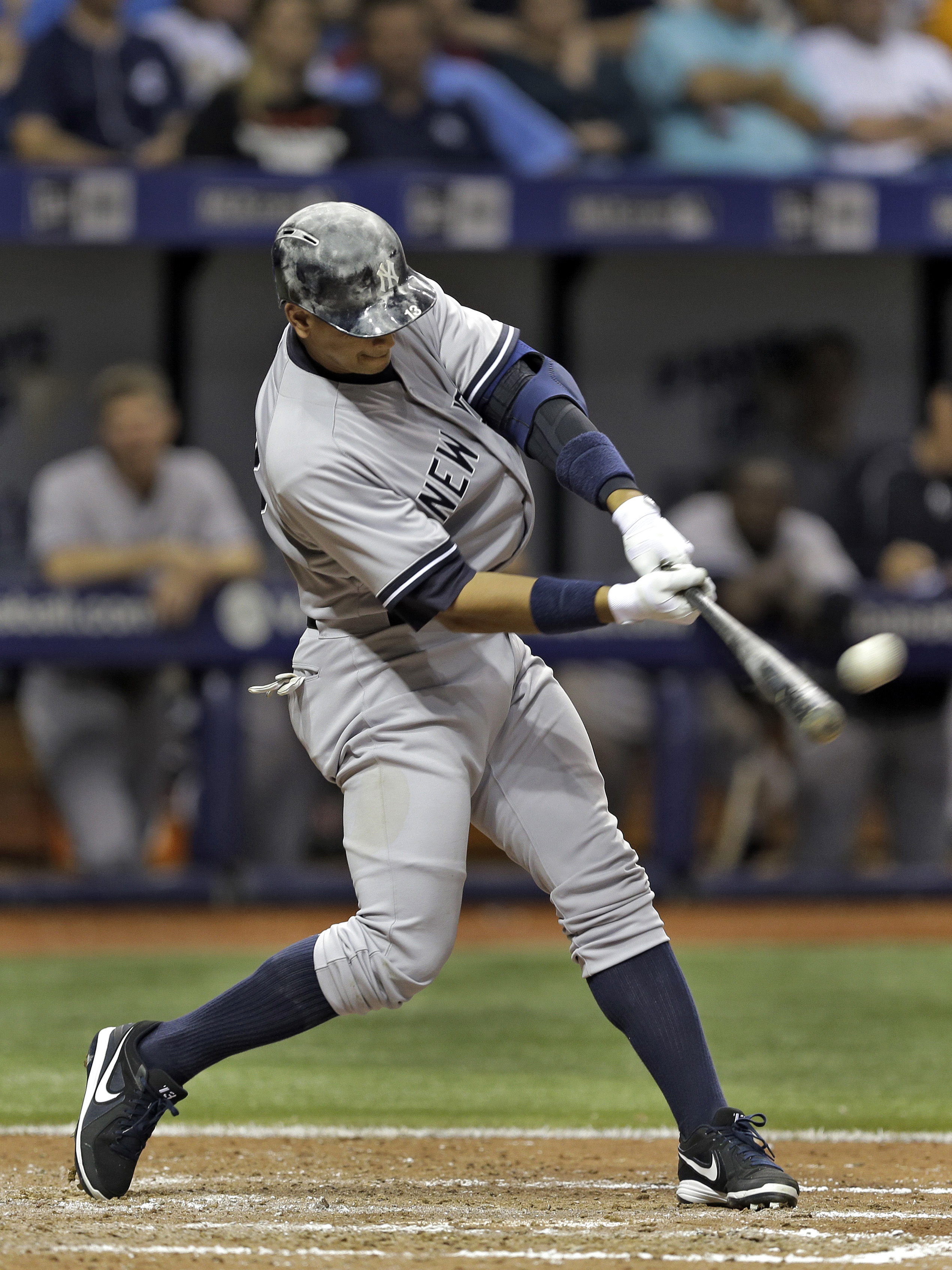 New York Yankees' Alex Rodriguez connects for a two-run home run off Tampa Bay Rays relief pitcher Ernesto Frieri during the sixth inning of a baseball game Friday, April 17, 2015, in St. Petersburg, Fla. Yankees' Brian McCann also scored. (AP Photo/Chris