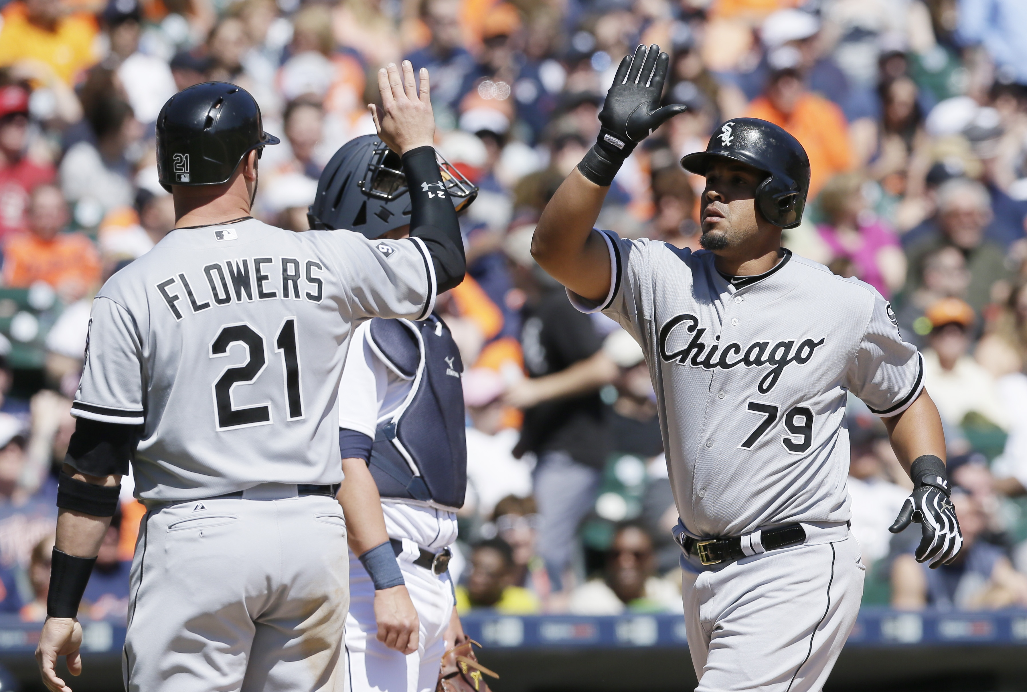 Chicago White Sox's Jose Abreu (79) greets Tyler Flowers after Abreu's grand slam during the fourth inning of a baseball game against the Detroit Tigers, Saturday, April 18, 2015, in Detroit. (AP Photo/Carlos Osorio)