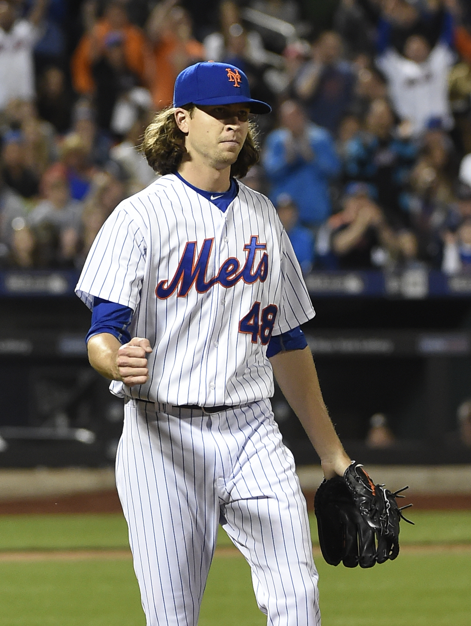New York Mets starting pitcher Jacob deGrom (48) pumps his fist after first baseman Lucas Duda caught Miami Marlins' Martin Prado's foul ball for the third out that left two runners on base in the sixth inning of a baseball game at Citi Field on Saturday,