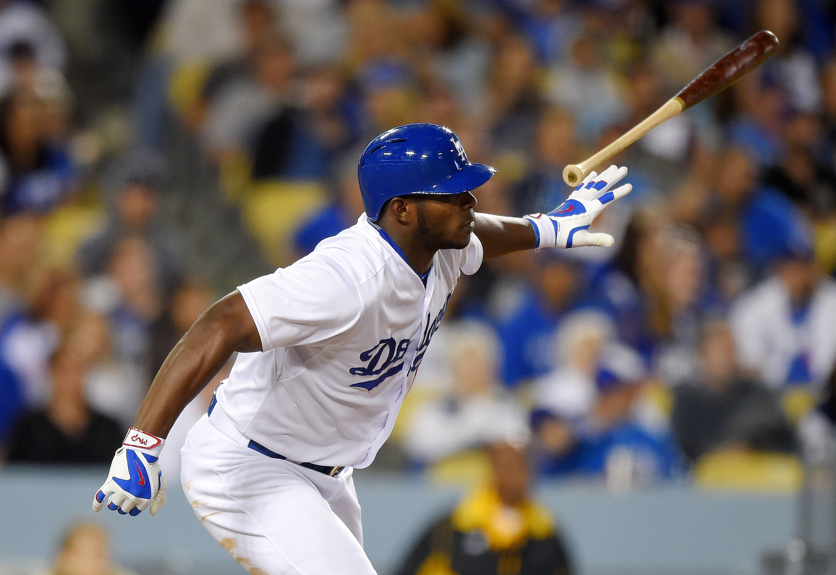 Los Angeles Dodgers' Yasiel Puig tosses his bat after an RBI double during the seventh inning of a baseball game against the Colorado Rockies, Saturday, April 18, 2015, in Los Angeles. (AP Photo/Mark J. Terrill)
