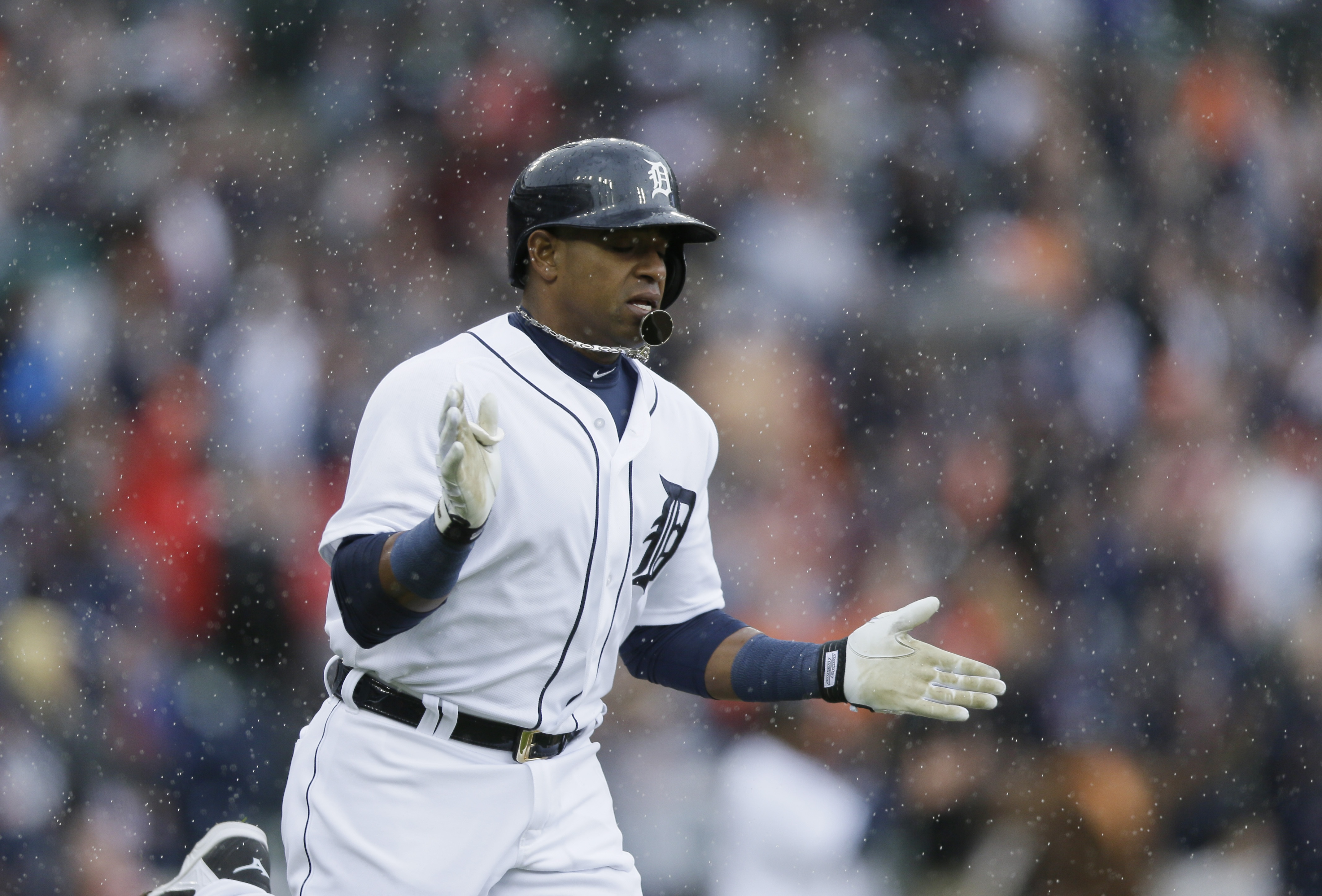 Detroit Tigers' Yoenis Cespedes rounds the bases after his grand slam off Chicago White Sox pitcher Jose Quintana during the first inning of a baseball game, Sunday, April 19, 2015, in Detroit. (AP Photo/Carlos Osorio)