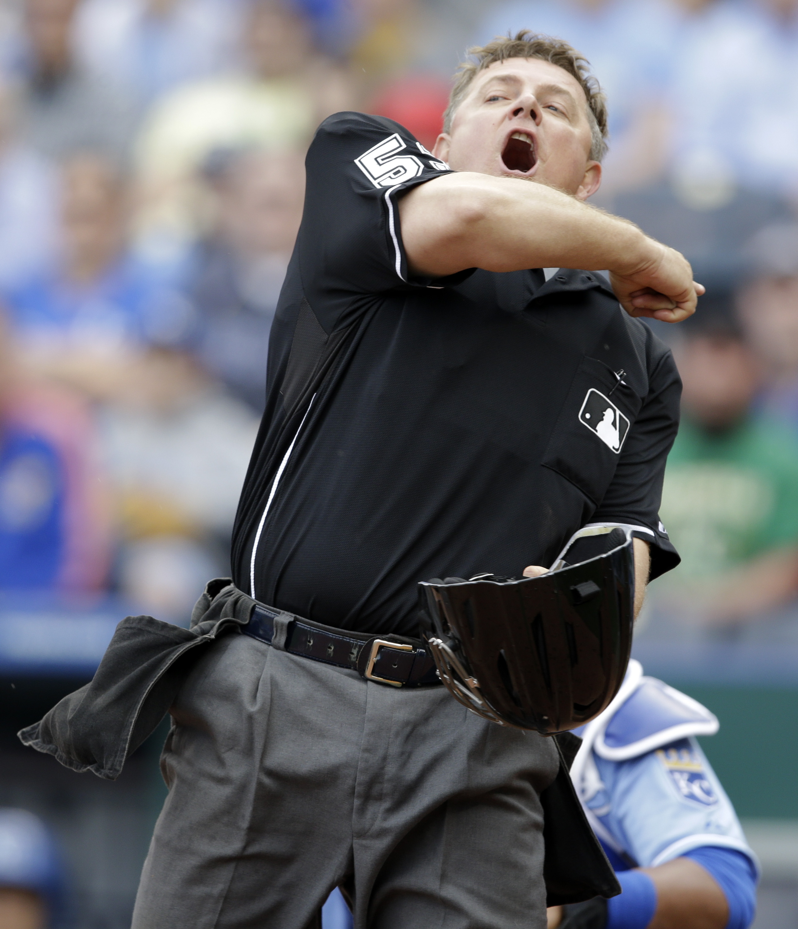Home plate umpire Greg Gibson (53) throws Kansas City Royals relief pitcher Kelvin Herrera out during the eighth inning of a baseball game against the Oakland Athletics at Kauffman Stadium in Kansas City, Mo., Sunday, April 19, 2015. Herrera threw at Oakl