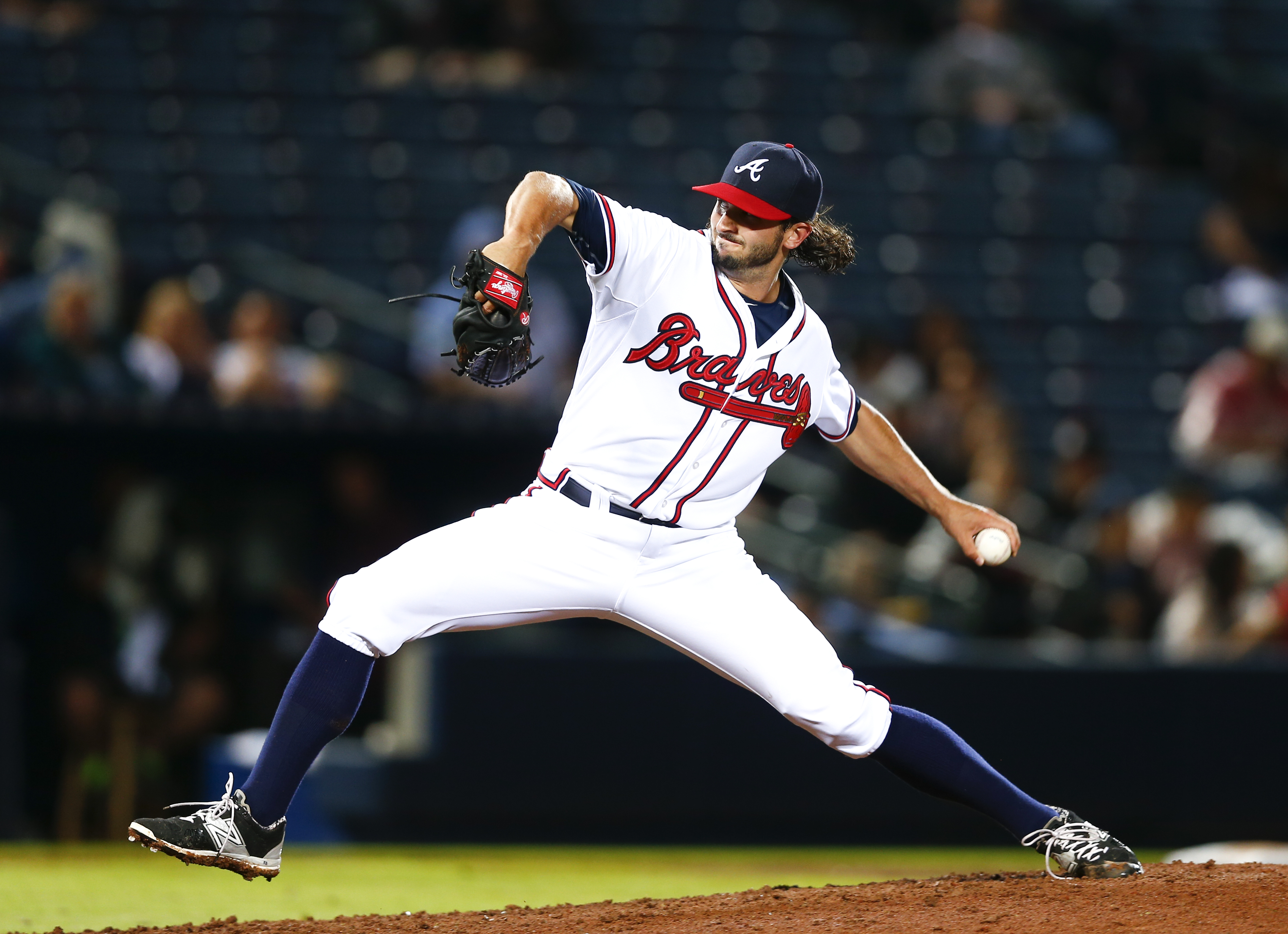 In this April 14, 2015 photo, Atlanta Braves relief pitcher Andrew McKirahan (52) delivers a pitch against the Miami Marlins during a baseball game, in Atlanta.  on Monday, April 20, McKirahan has been suspended for 80 games following a positive test for