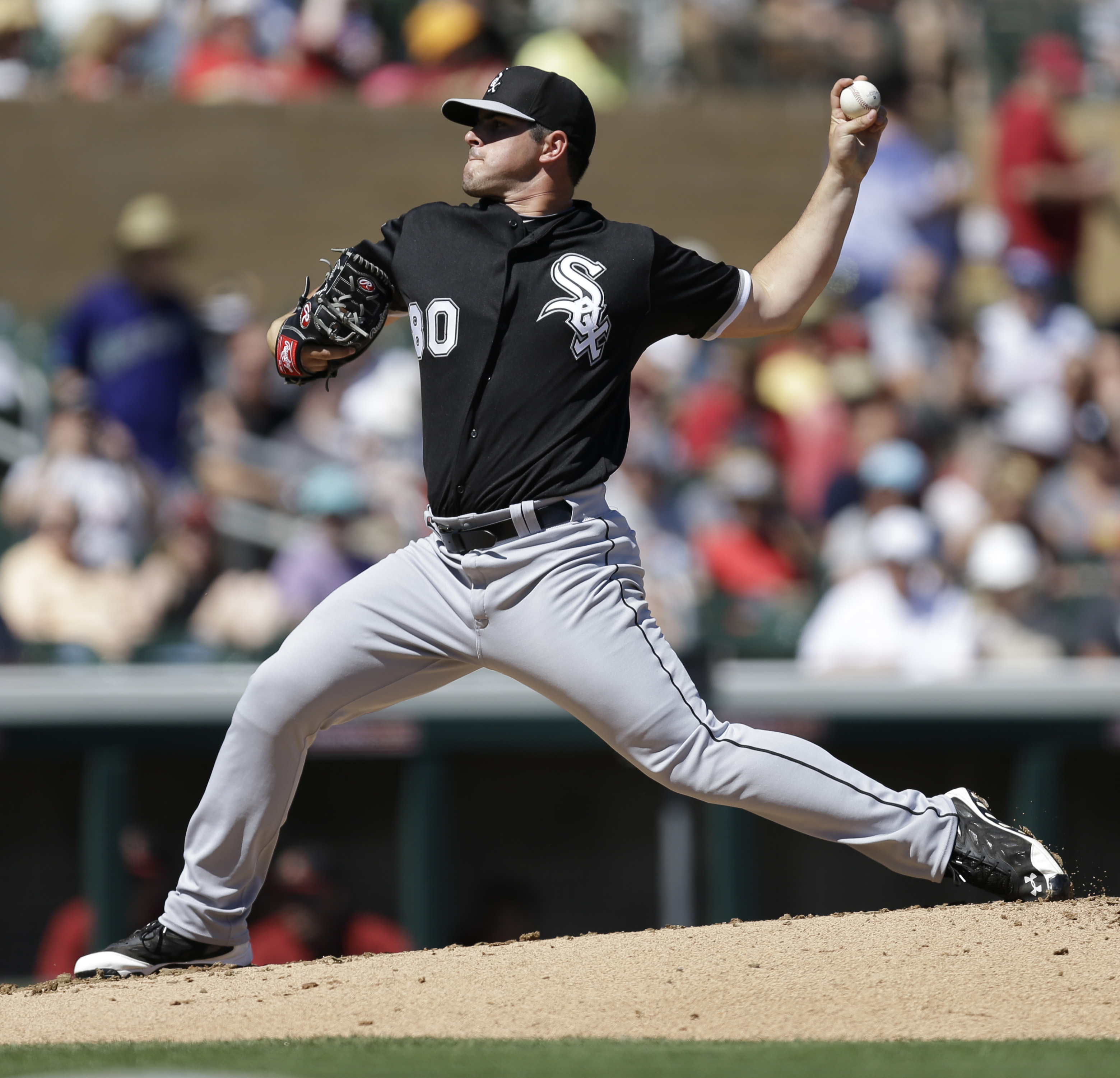 Chicago White Sox pitcher Carlos Rodon works against the Arizona Diamondbacks in the first inning of a spring training exhibition baseball game Monday, March 16, 2015, in Scottsdale, Ariz. (AP Photo/Ben Margot)
