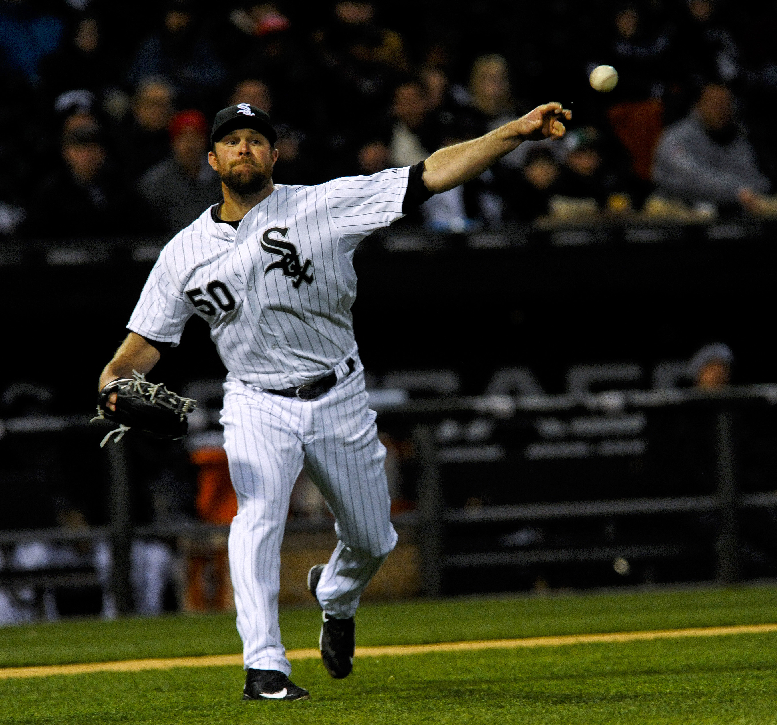 Chicago White Sox starting pitcher John Danks throws out Cleveland Indians shortstop Jose Ramirez after he attempted to bunt  during the third  inning of an baseball game on Monday, April 20, 2015, in Chicago. (AP Photo/Matt Marton)