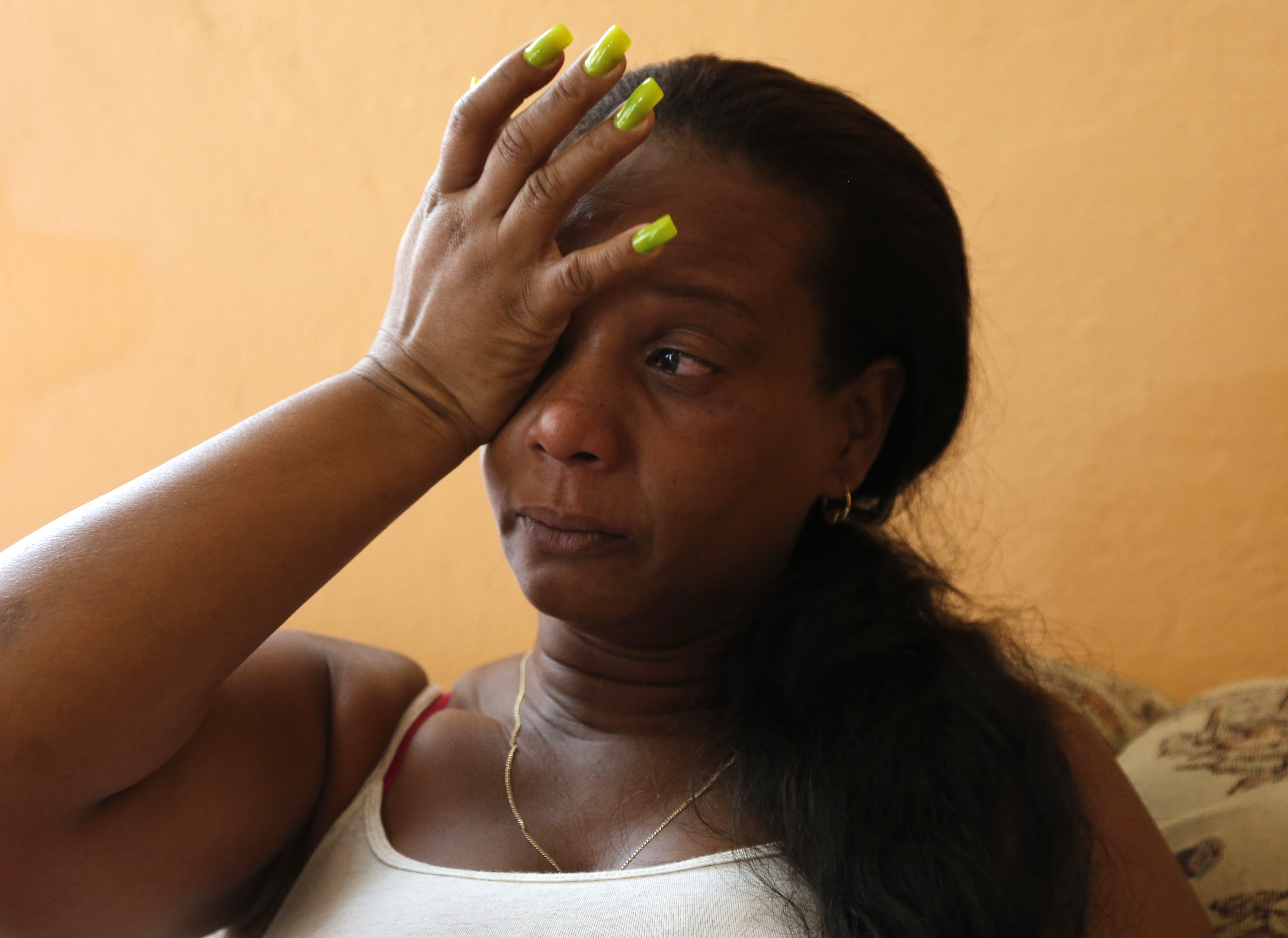 """In this March 3, 2015 photo, Melba Rosa Bacallao, mother of Cuban baseball player Yasmany Tomas, is overcome by emotion as she talks about her son during an interview at her home in Havana, Cuba. """"I miss him so much. It's tough,"""" said Rosita, her voice cr"""