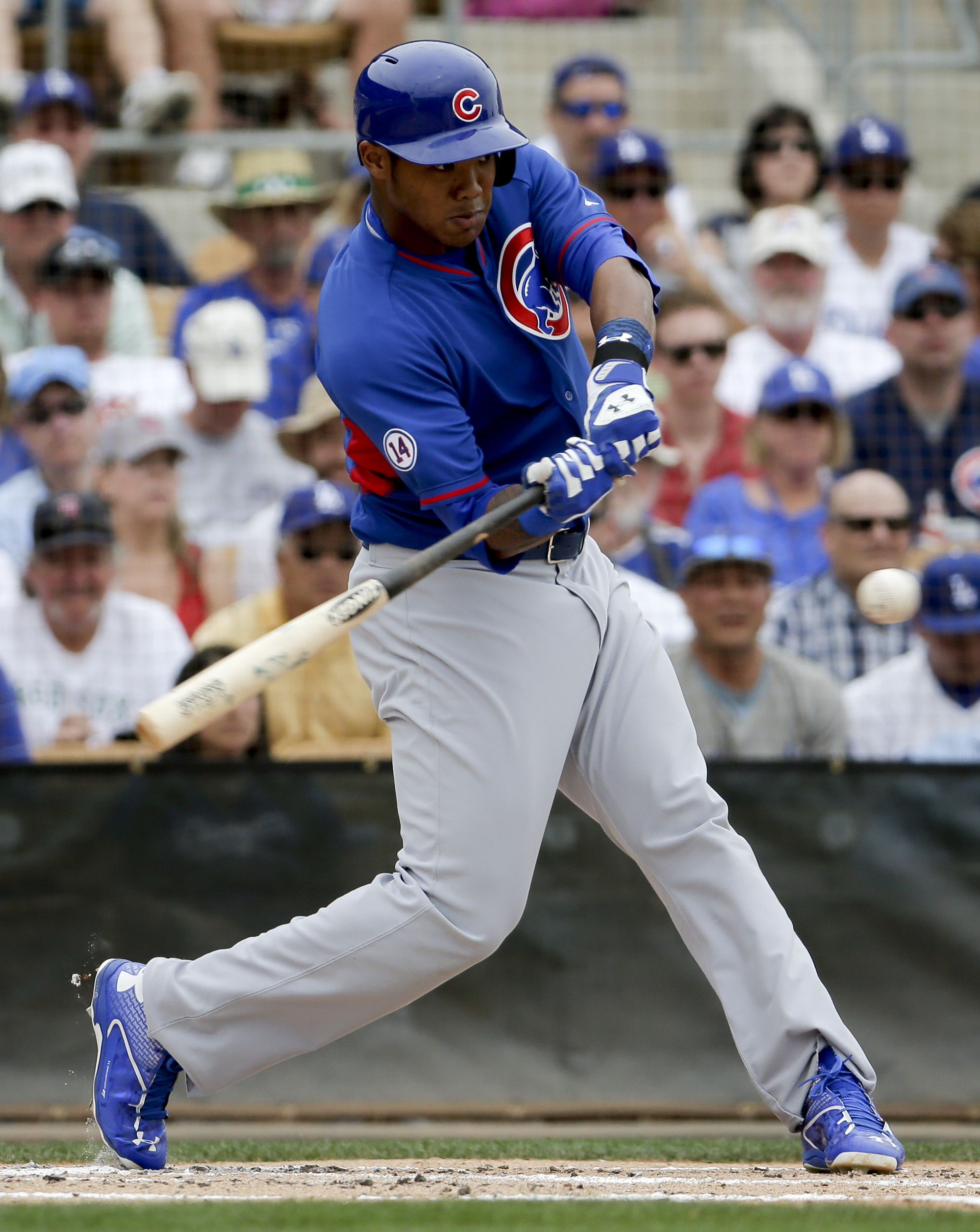 Chicago Cubs' Addison Russell bats during a spring training baseball exhibition game against the Los Angeles Dodgers in Glendale, Ariz., on Wednesday, March 18, 2015. (AP Photo/Chris Carlson)