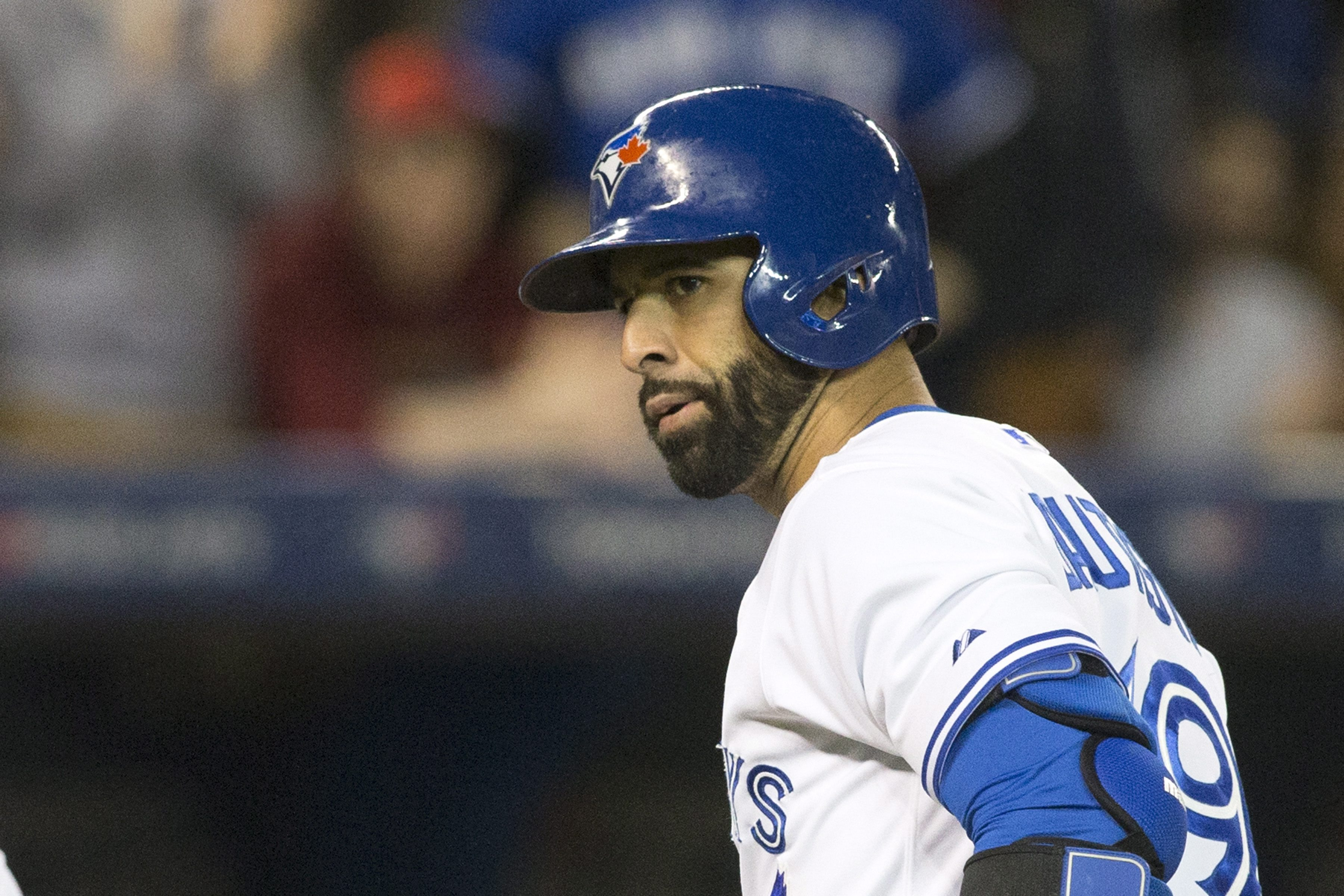 Toronto Blue Jays Jose Bautista looks over at the Baltimore Orioles bench after hitting a two-run home run during the seventh inning of a baseball game Tuesday, April 21, 2015, in Toronto. (Chris Young/The Canadian Press via AP)