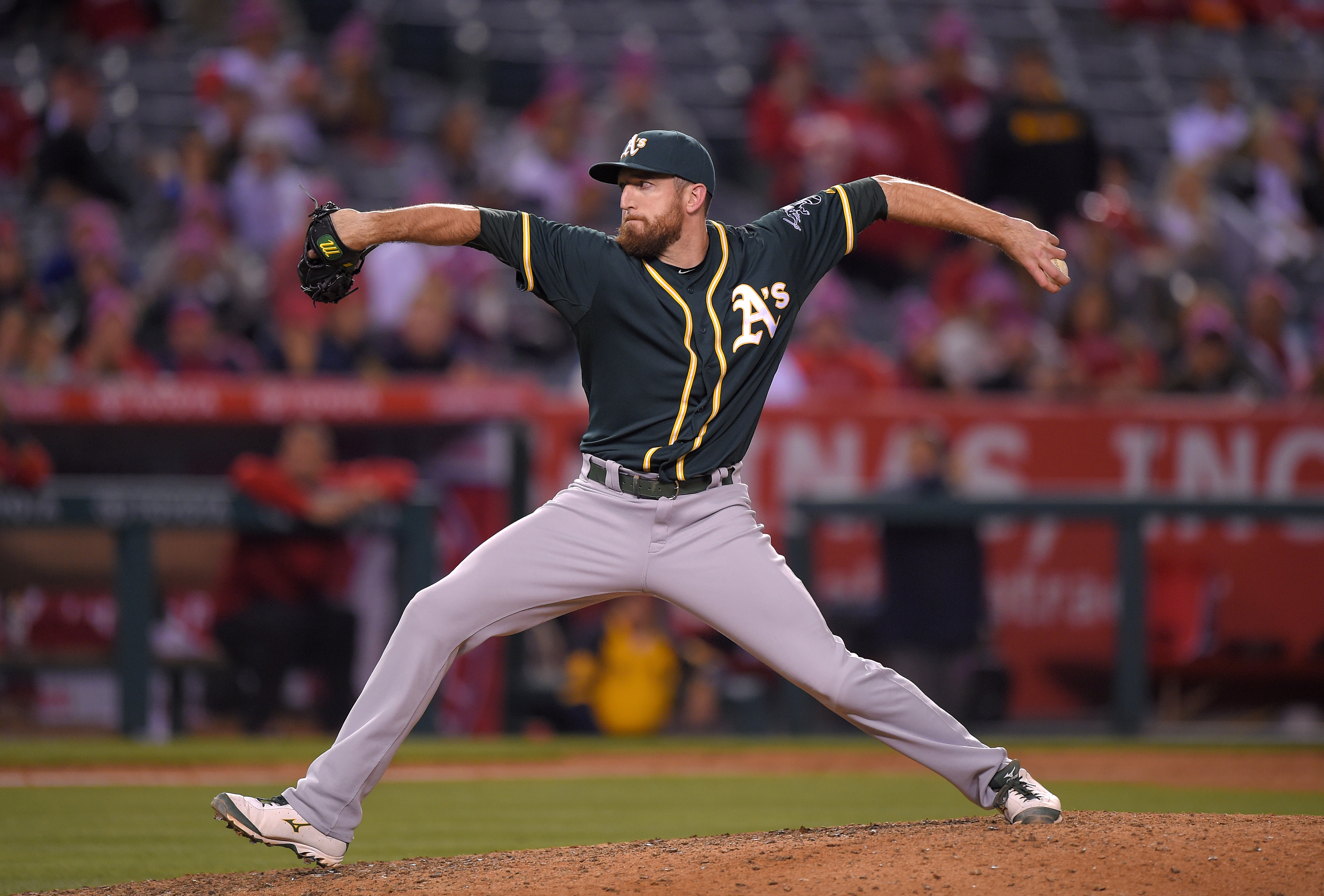 Oakland Athletics first baseman Ike Davis pitches during the eighth inning of a baseball game against the Los Angeles Angels, Tuesday, April 21, 2015, in Anaheim, Calif. (AP Photo/Mark J. Terrill)