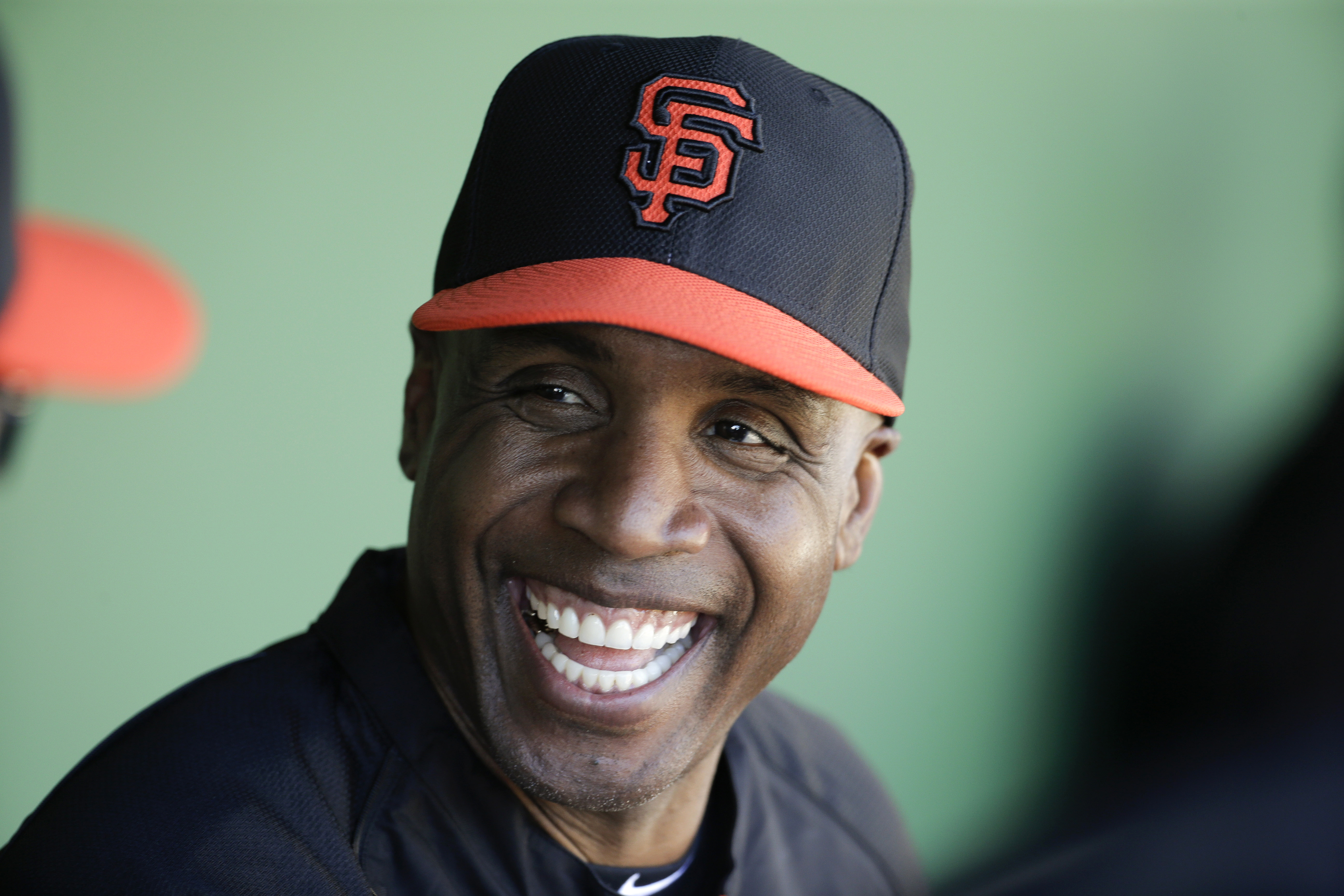 FILE - In this March 10, 2014, file photo, former San Francisco Giants Barry Bonds chats to the dugout during a spring training baseball game in Scottsdale, Ariz. Bonds' obstruction of justice conviction reversed by 9th US Circuit Court of Appeals on Wedn