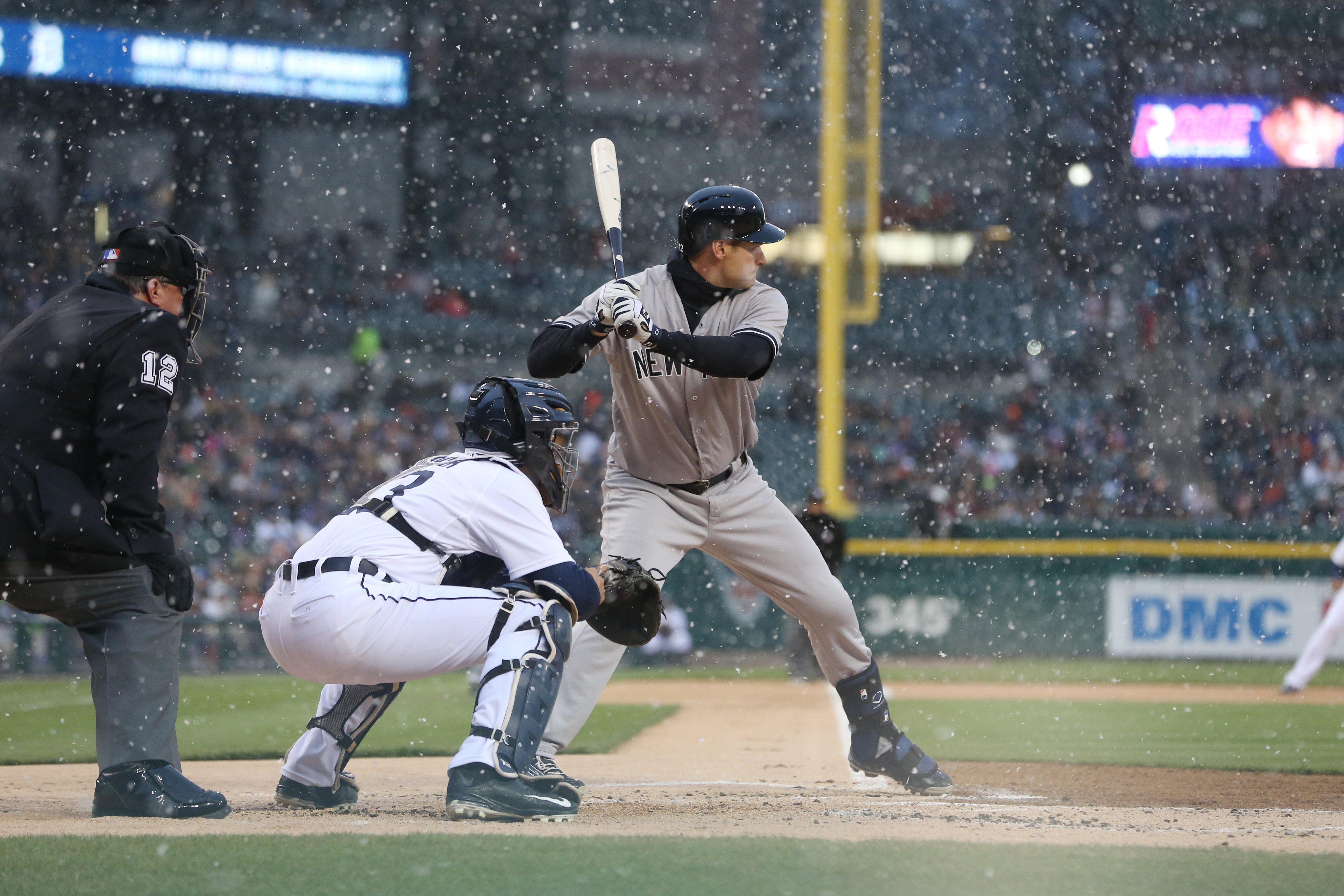New York Yankees' Chase Headley bats as snow falls during the first inning of a baseball game against the Detroit Tigers, Wednesday, April 22, 2015, in Detroit. (AP Photo/Carlos Osorio)