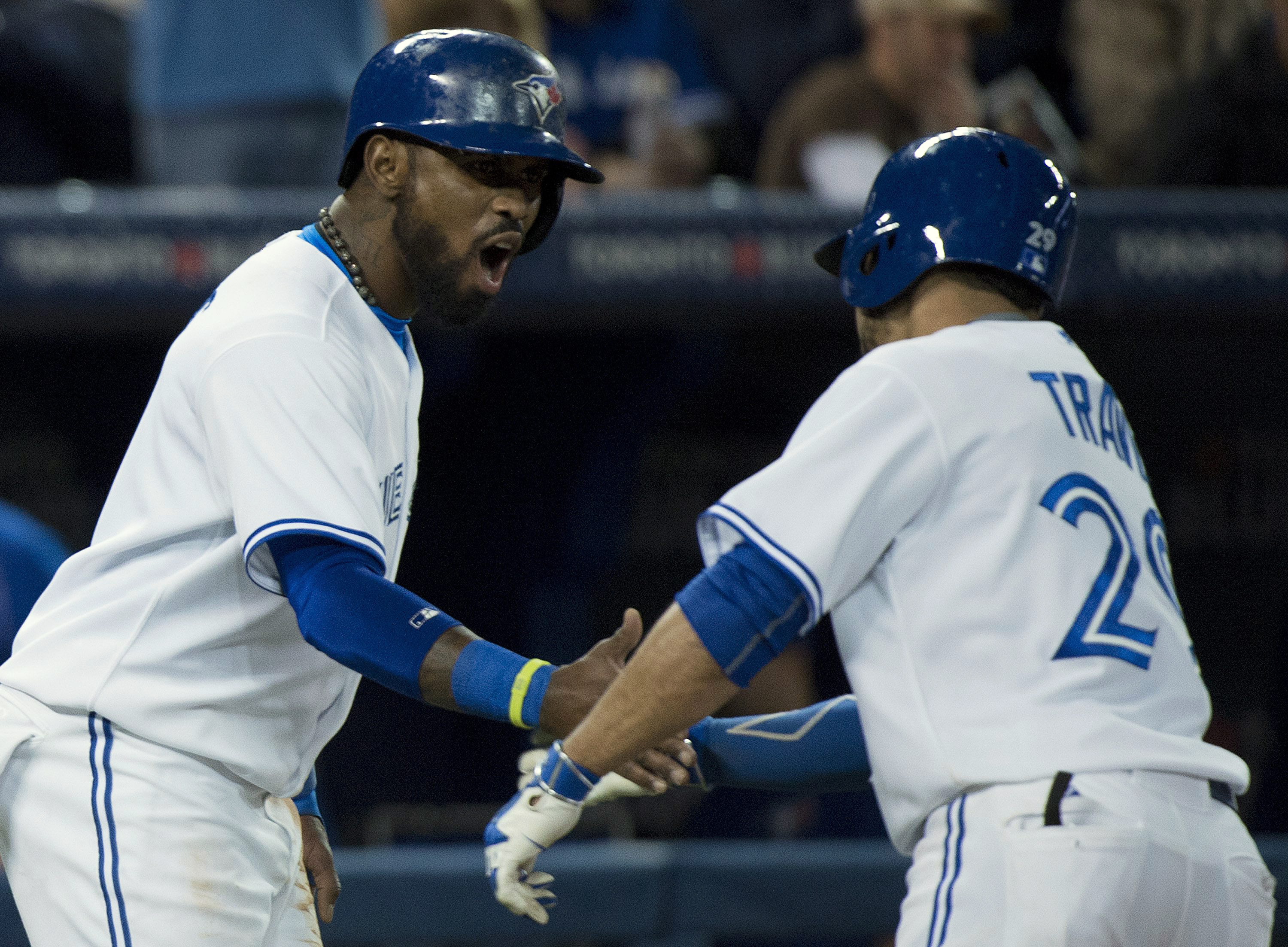 Toronto Blue Jays second baseman Devon Travis, right, celebrates his two run home run with teammate Jose Reyes while play against the Baltimore Orioles during fifth inning baseball action in Toronto on Wednesday, April 22, 2015. (Nathan Denette/The Canadi