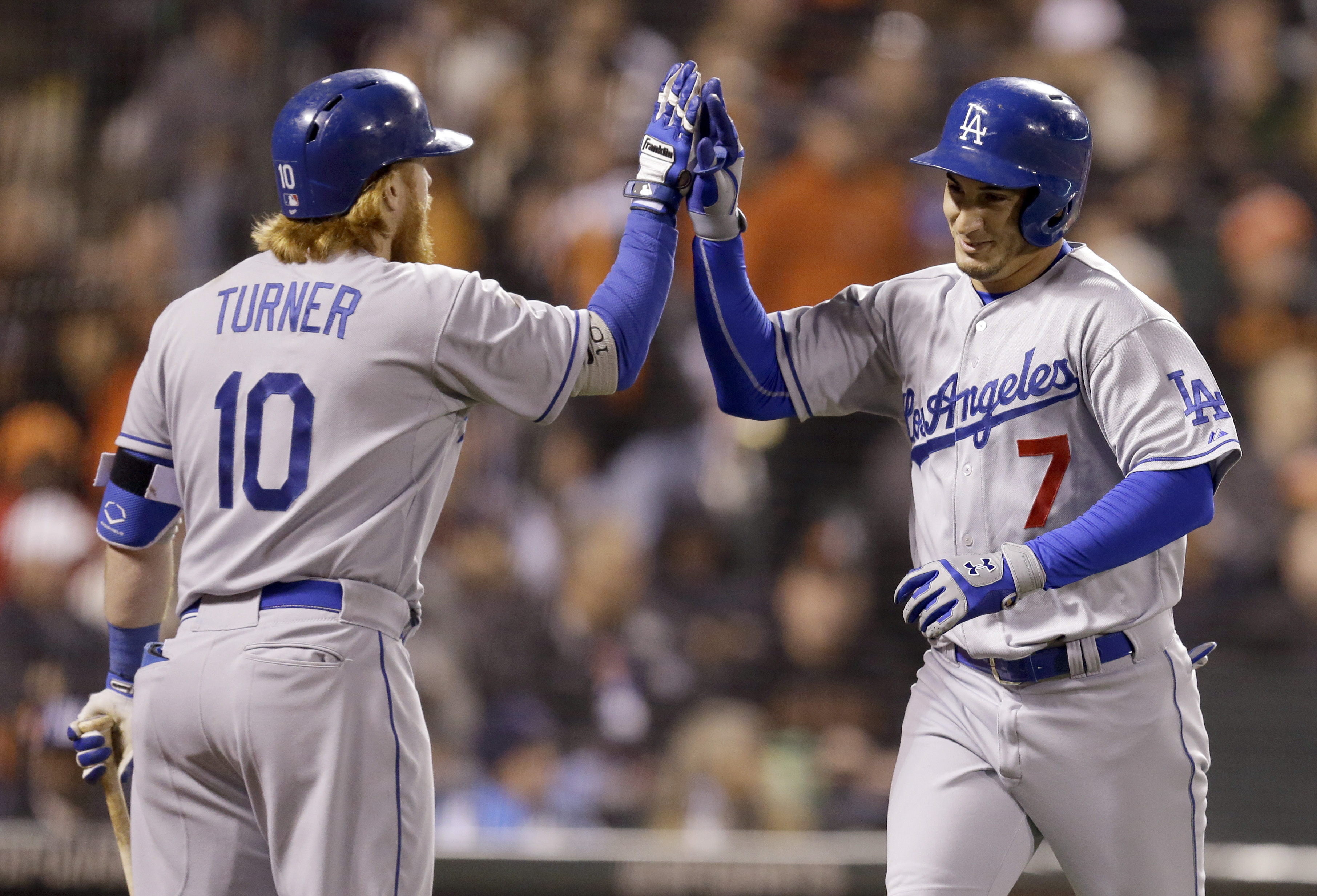 Los Angeles Dodgers' Alex Guerrero, right, is congratulated by Justin Turner (10) after Guerrero hit a two-run home run off San Francisco Giants' Madison Bumgarner in the seventh inning of a baseball game Wednesday, April 22, 2015, in San Francisco. (AP P