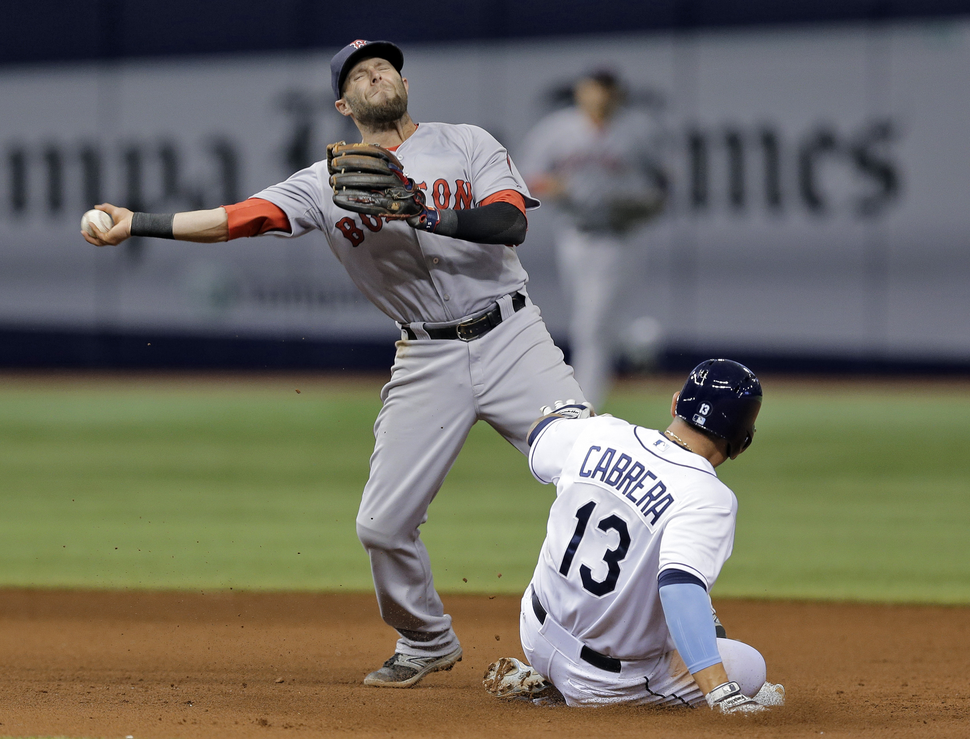 Boston Red Sox second baseman Dustin Pedroia forces Tampa Bay Rays' Asdrubal Cabrera (13) at second base on a ball hit by Desmond Jennings, who was safe at first during the sixth inning of a baseball game Thursday, April 23, 2015, in St. Petersburg, Fla.