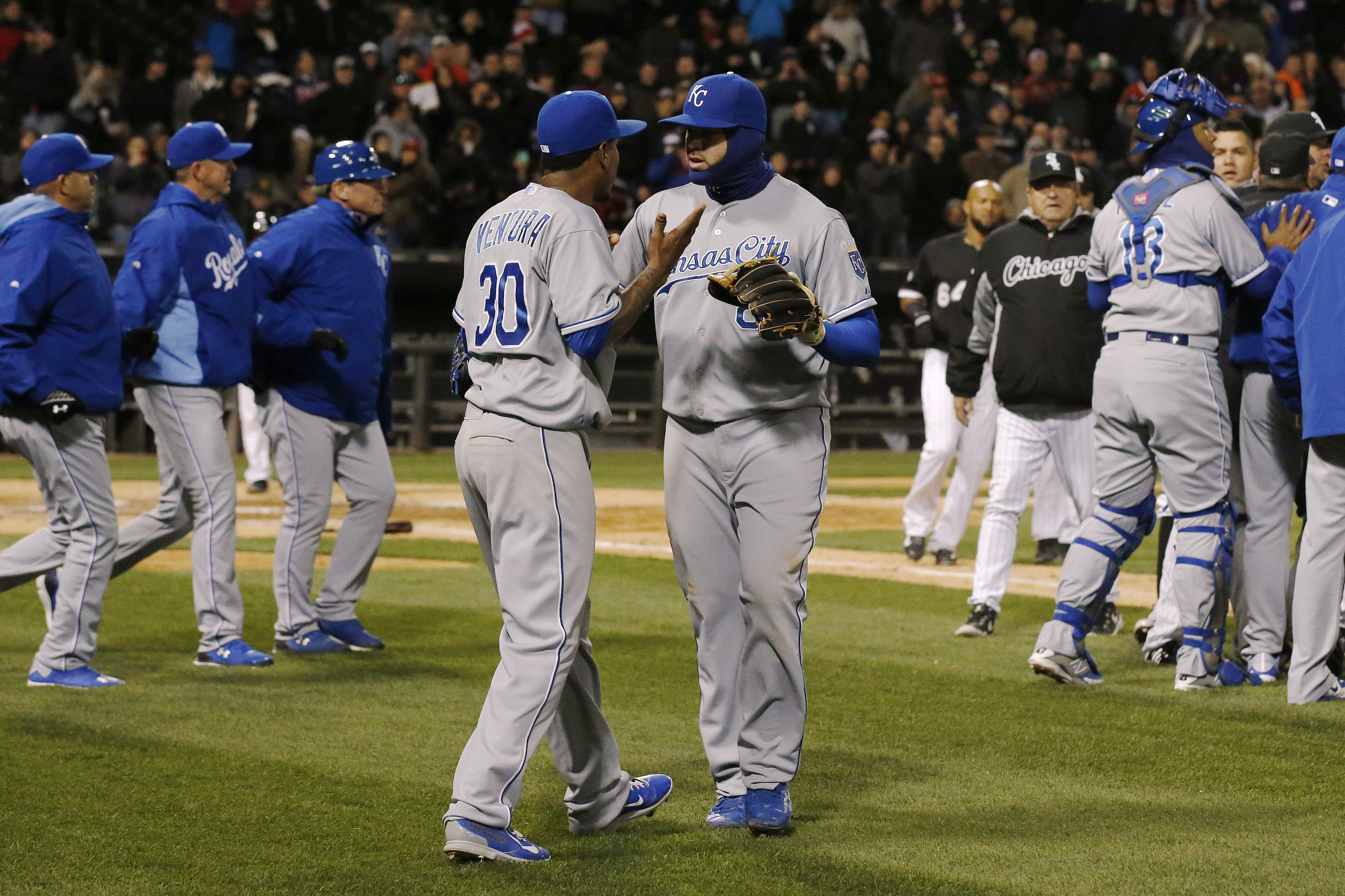 Kansas City Royals starting pitcher Yordano Ventura (30) is pulled aside by teammate Mike Moustakas as the benches clear during the seventh inning of a baseball game against the Chicago White Sox on Thursday, April 23, 2015, in Chicago. The Royals won 3-2
