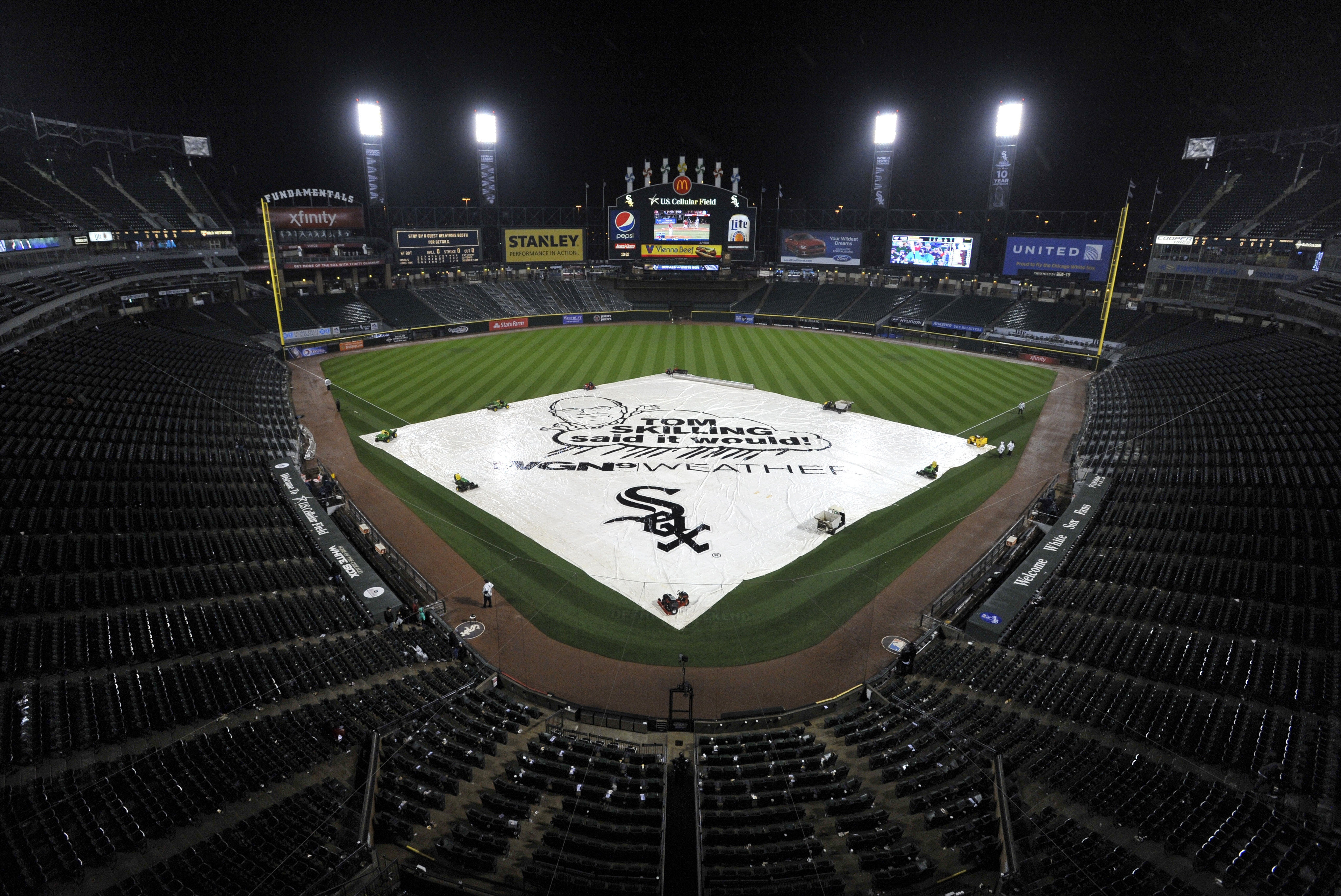 The tarp covers the infield at U.S. Cellular Field during a rain delay in a baseball game between the Chicago White Sox and Kansas City Royals after eight innings with the score 2-2, Friday, April 24, 2015, in Chicago. (AP Photo/Paul Beaty)