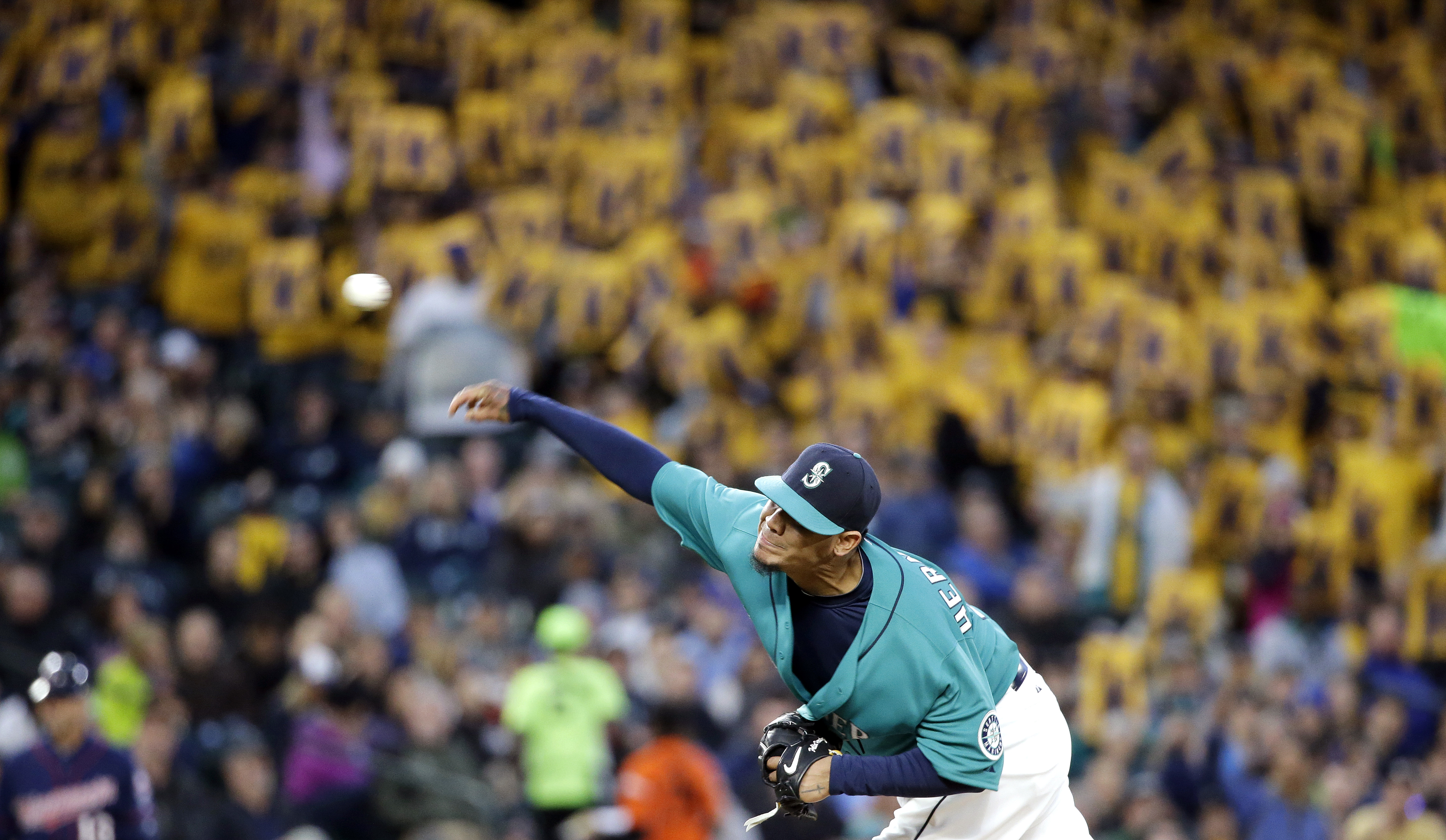 "Seattle Mariners starting pitcher Felix Hernandez throws, with a backdrop of yellow ""K"" strikeout cards held by fans, during the fifth inning of the Mariners' baseball game against the Minnesota Twins on Friday, April 24, 2015, in Seattle. (AP Photo/Elain"