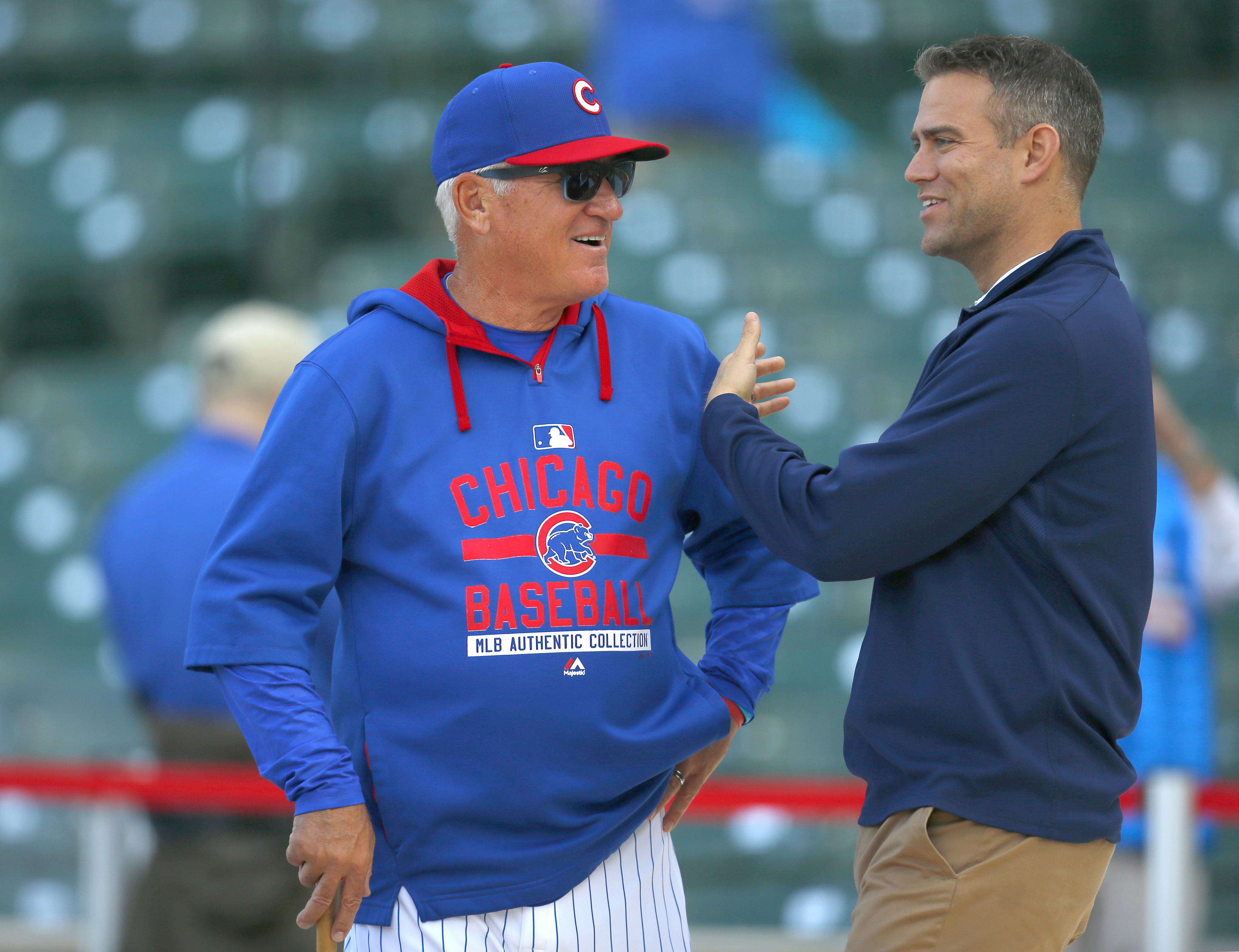 FILE - In this April 13, 2015, file photo, Theo Epstein, right, Chicago Cubs president of baseball operations, talks with Cubs manager Joe Maddon during batting practice before the Cubs' baseball game against the Cincinnati Reds in Chicago. With runs at a