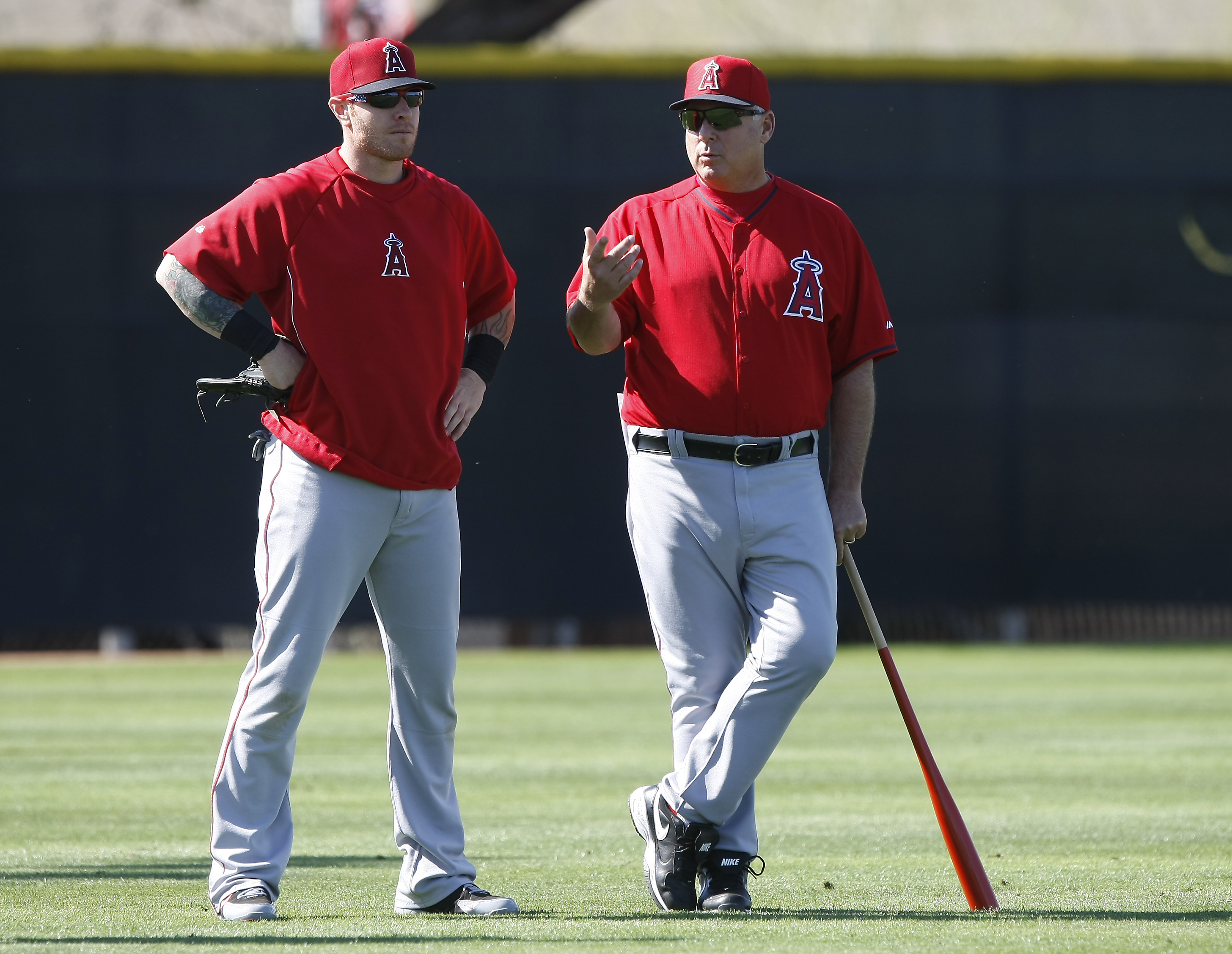 FILE - In this Feb. 20, 2014, file photo,Los Angeles Angels left fielder Josh Hamilton, left, talks to manager Mike Scioscia during spring training baseball practice in Tempe, Ariz. Reports that troubled Los Angeles Angels outfielder Josh Hamilton might b