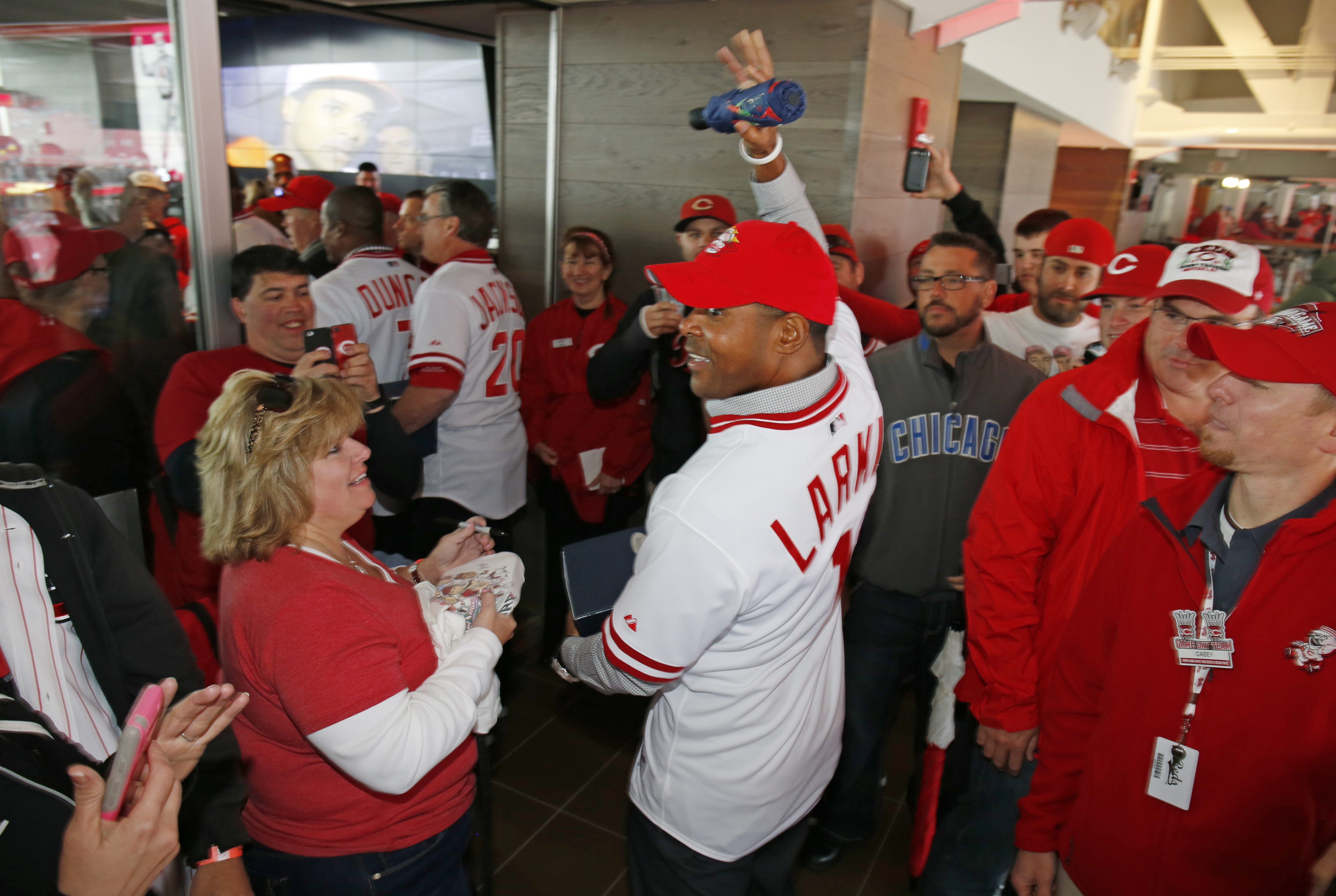 Former Cincinnati Reds' shortstop, Barry Larkin, a member of the Cincinnati Reds 1990 World Series championship team, waves to fans after the 1990 team was honored in a ceremony before a baseball game between the Chicago Cubs and Cincinnati Reds, Saturday