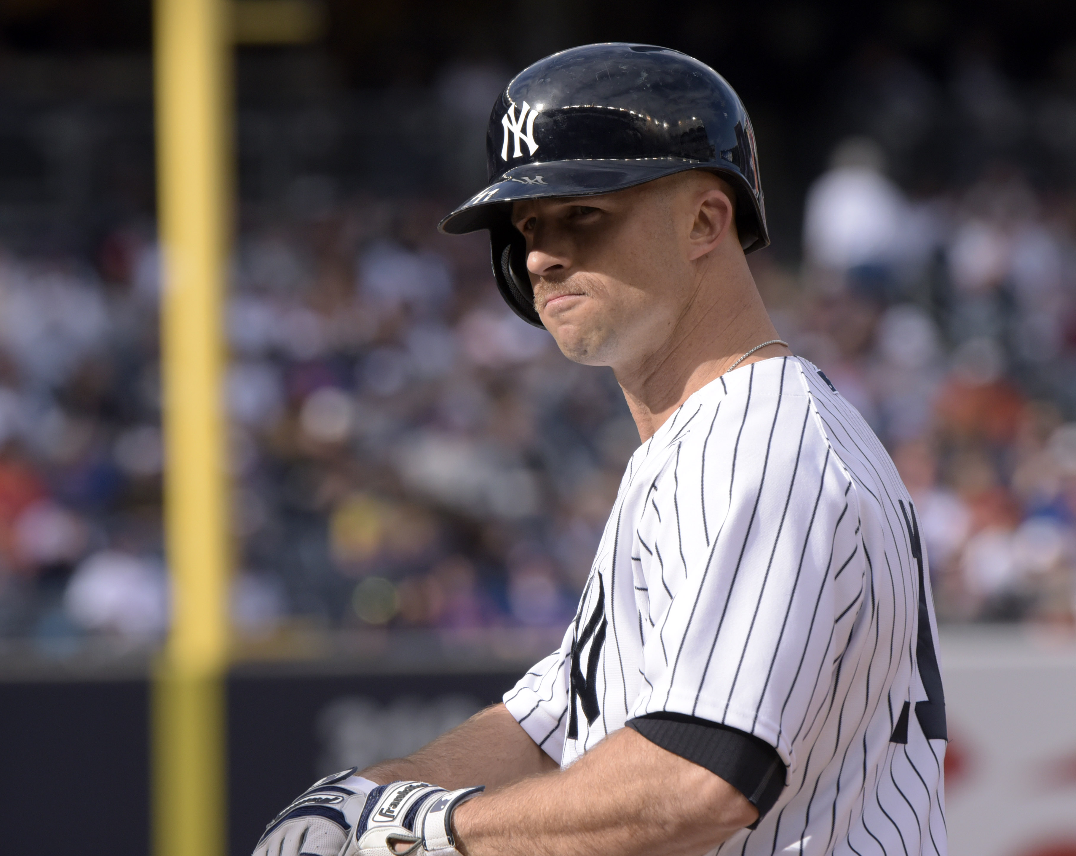 New York Yankees' Brett Gardner sports a mustache as he stands on first base after drawing a walk during the third inning of an interleague baseball game agains the New York Mets Saturday, April 25, 2015, at Yankee Stadium in New York. (AP Photo/Bill Kost