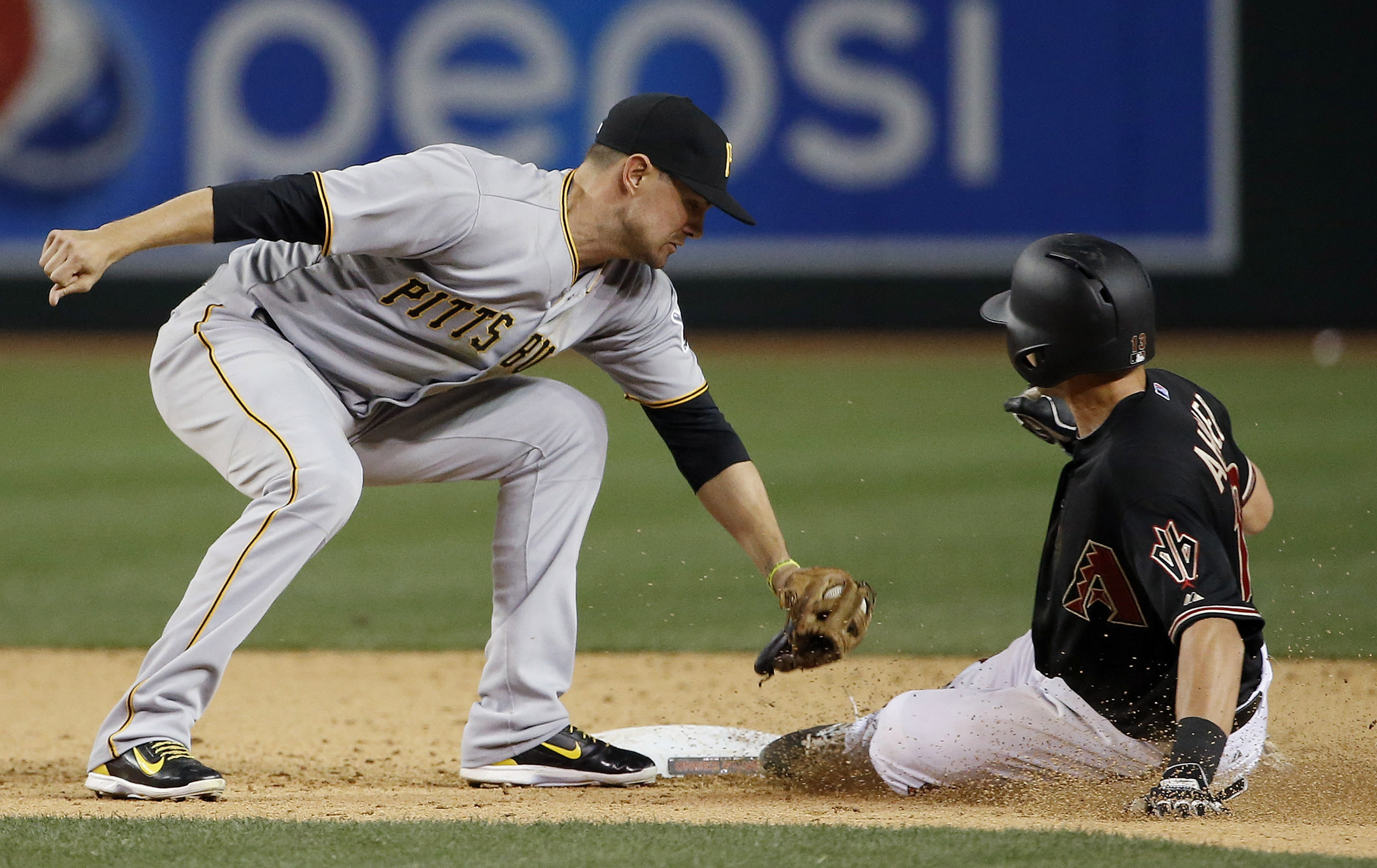 Pittsburgh Pirates' Jordy Mercer, left, tags out Arizona Diamondbacks' Nick Ahmed, right, as he tries to steal second base during the ninth inning of a baseball game Saturday, April 25, 2015, in Phoenix. The Pirates defeated the Diamondbacks 2-1. (AP Phot