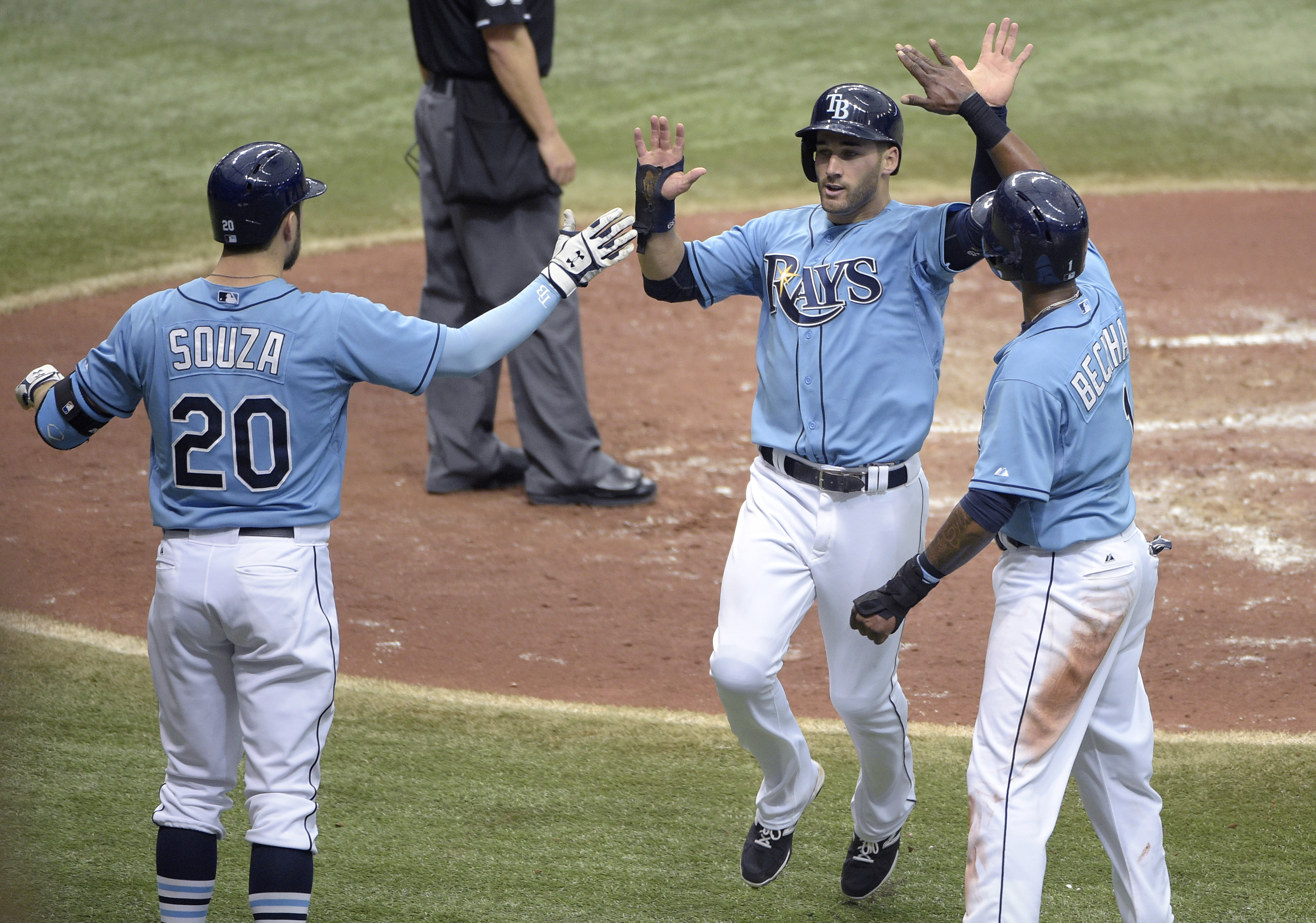 Tampa Bay Rays' Kevin Kiermaier, center, is congratulated by Steven Souza Jr. (20) and Tim Beckham, right, after scoring off a single by Brandon Guyer during the sixth inning of a baseball game against the Toronto Blue Jays in St. Petersburg, Fla., Sunday