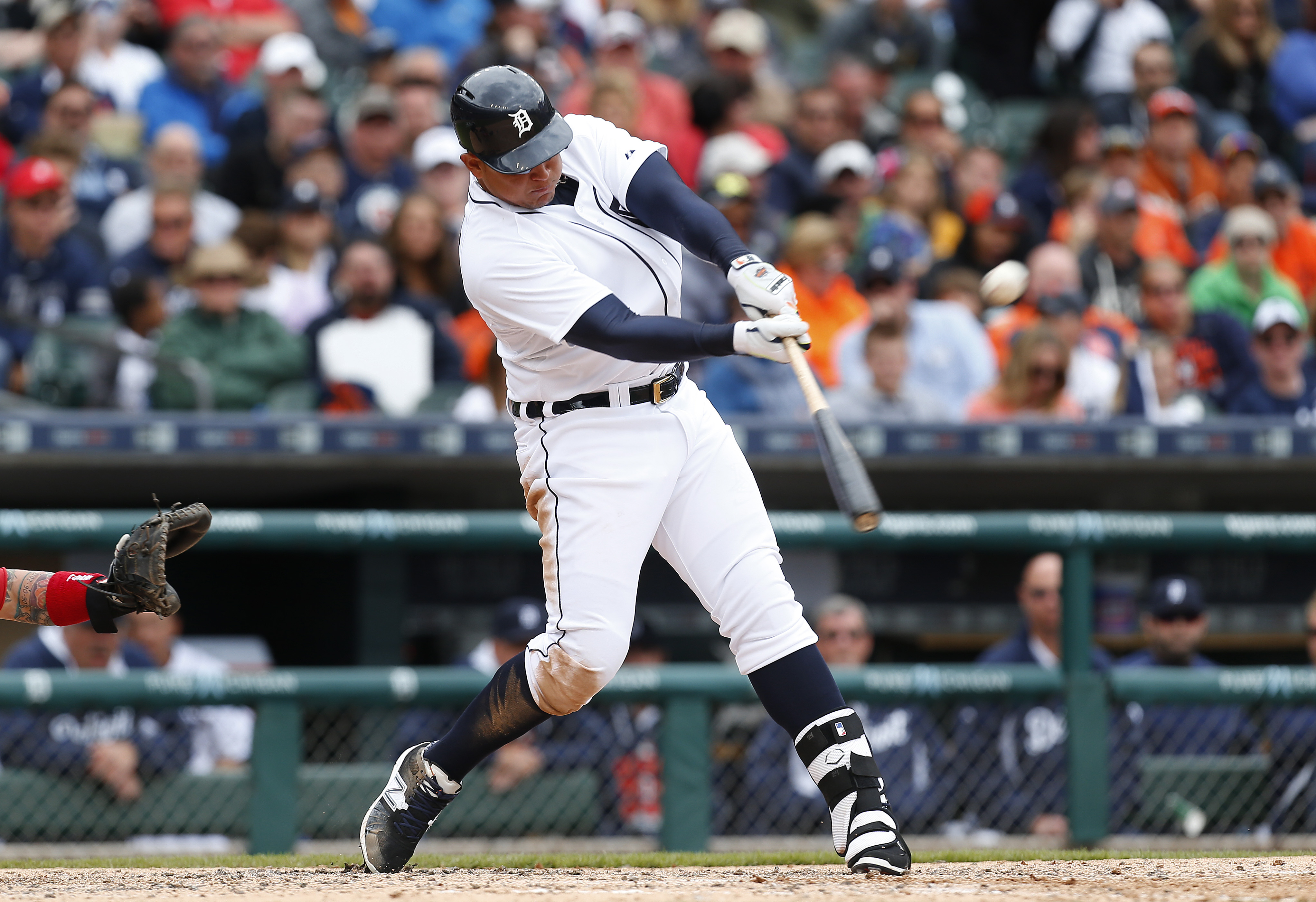 Detroit Tigers' Miguel Cabrera hits a two-ruin home run against the Cleveland Indians in the sixth inning of a baseball game in Detroit, Sunday, April 26, 2015. (AP Photo/Paul Sancya)