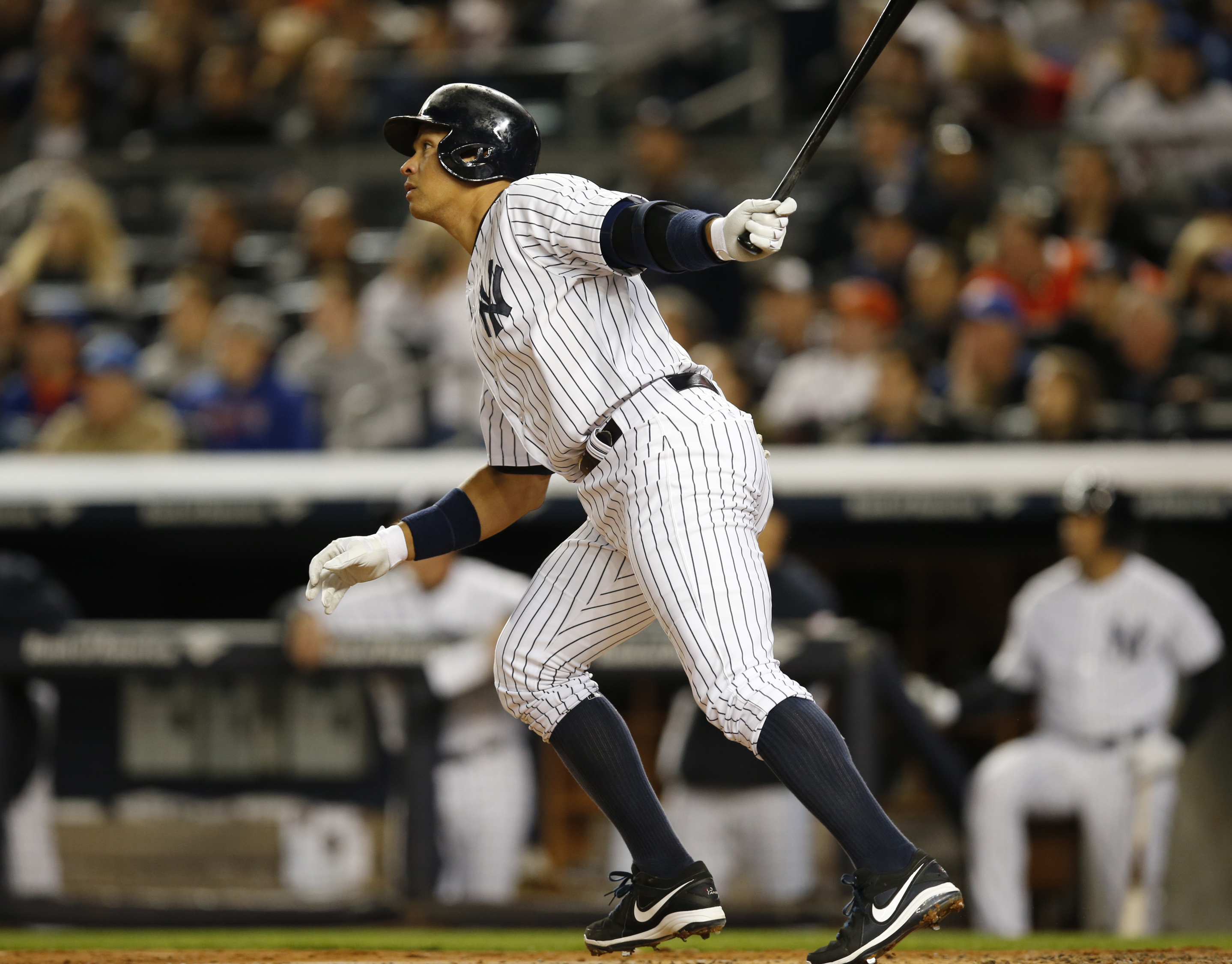 New York Yankees designated hitter Alex Rodriguez (13) hits a first-inning solo home run in a baseball game against the New York Mets at Yankee Stadium in New York, Sunday, April 26, 2015. Rodriguez now stands at 659 career home runs and needs one more to