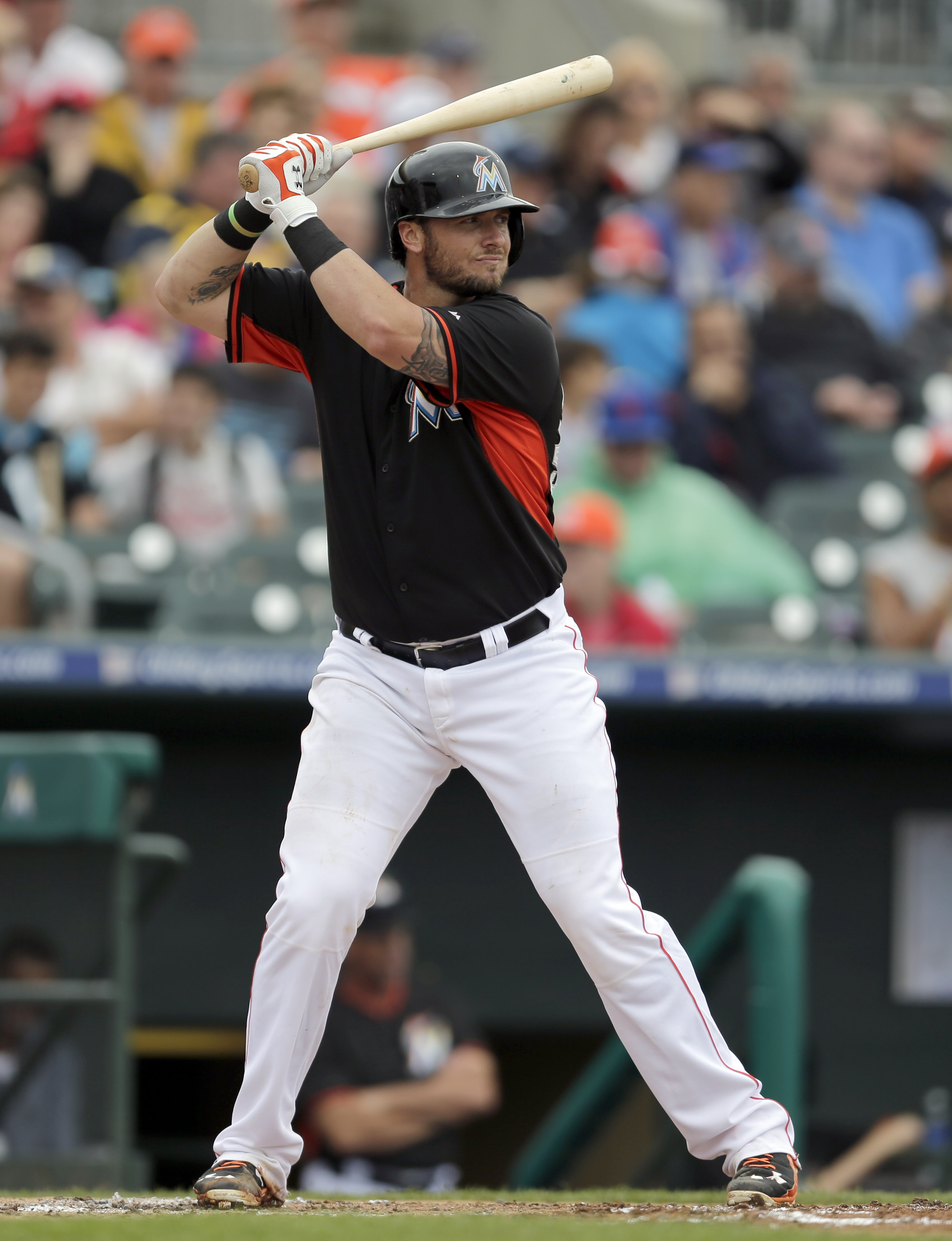 Miami Marlins' Jarrod Saltalamacchia bats during the second inning of an exhibition spring training baseball game against the New York Mets Saturday, March 7, 2015, in Jupiter, Fla. (AP Photo/Jeff Roberson)