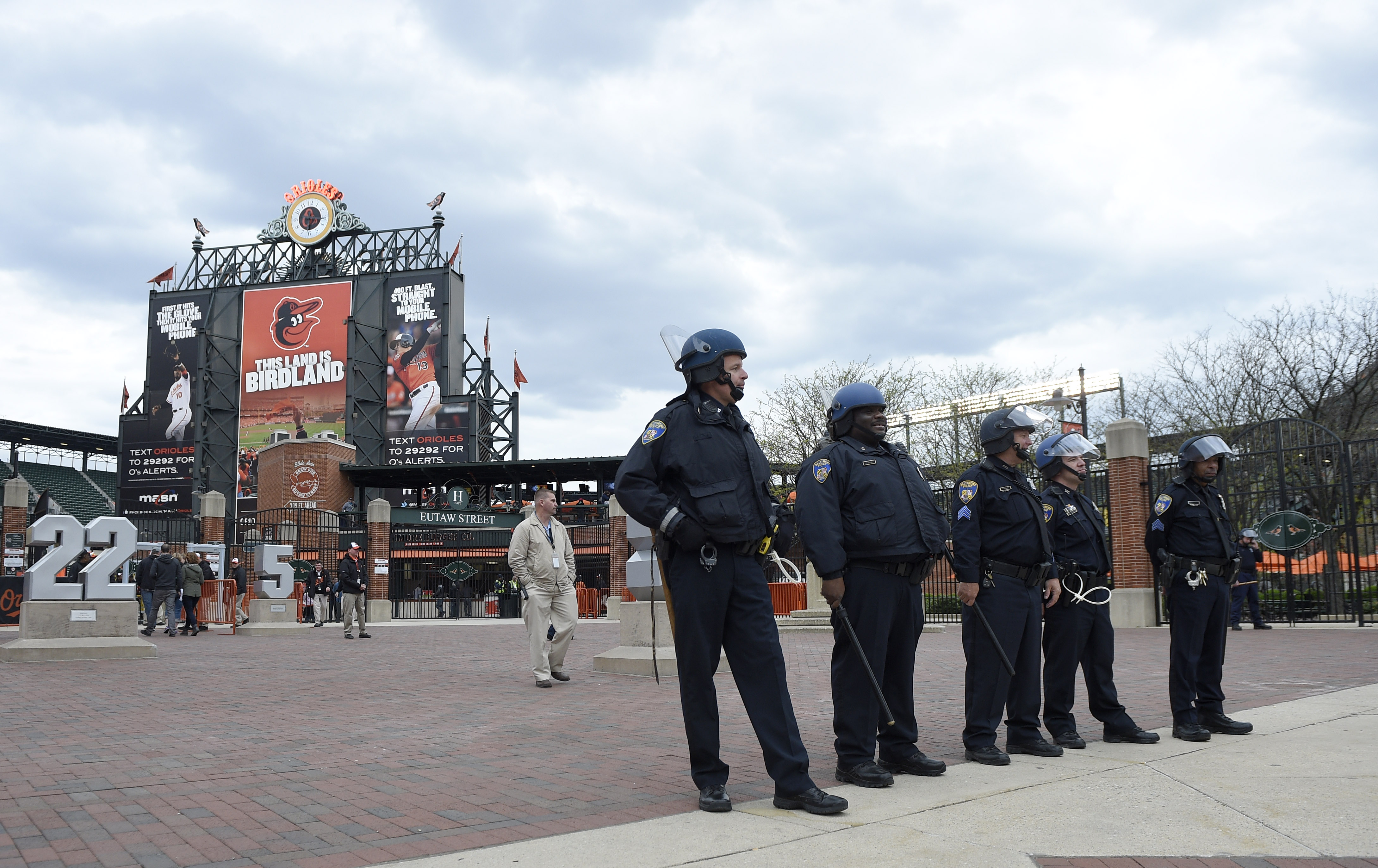 Baltimore police officers stand guard outside of Oriole Park at Camden Yards, Monday, April 27, 2015, in Baltimore. The baseball game between the Baltimore Orioles and the Chicago White Sox has been postponed. (AP Photo/Nick Wass)