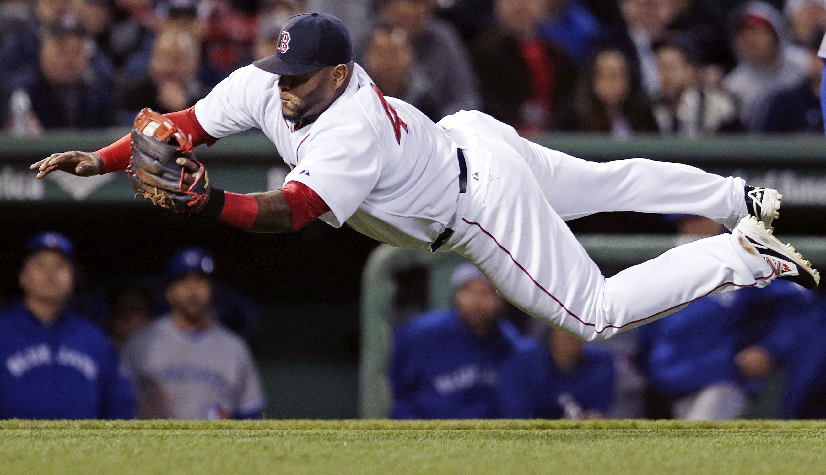 Boston Red Sox third baseman Pablo Sandoval makes a diving catch on a fly out by Toronto Blue Jays'  Dalton Pompey during the fourth inning of a baseball game at Fenway Park in Boston, Monday, April 27, 2015. (AP Photo/Charles Krupa)