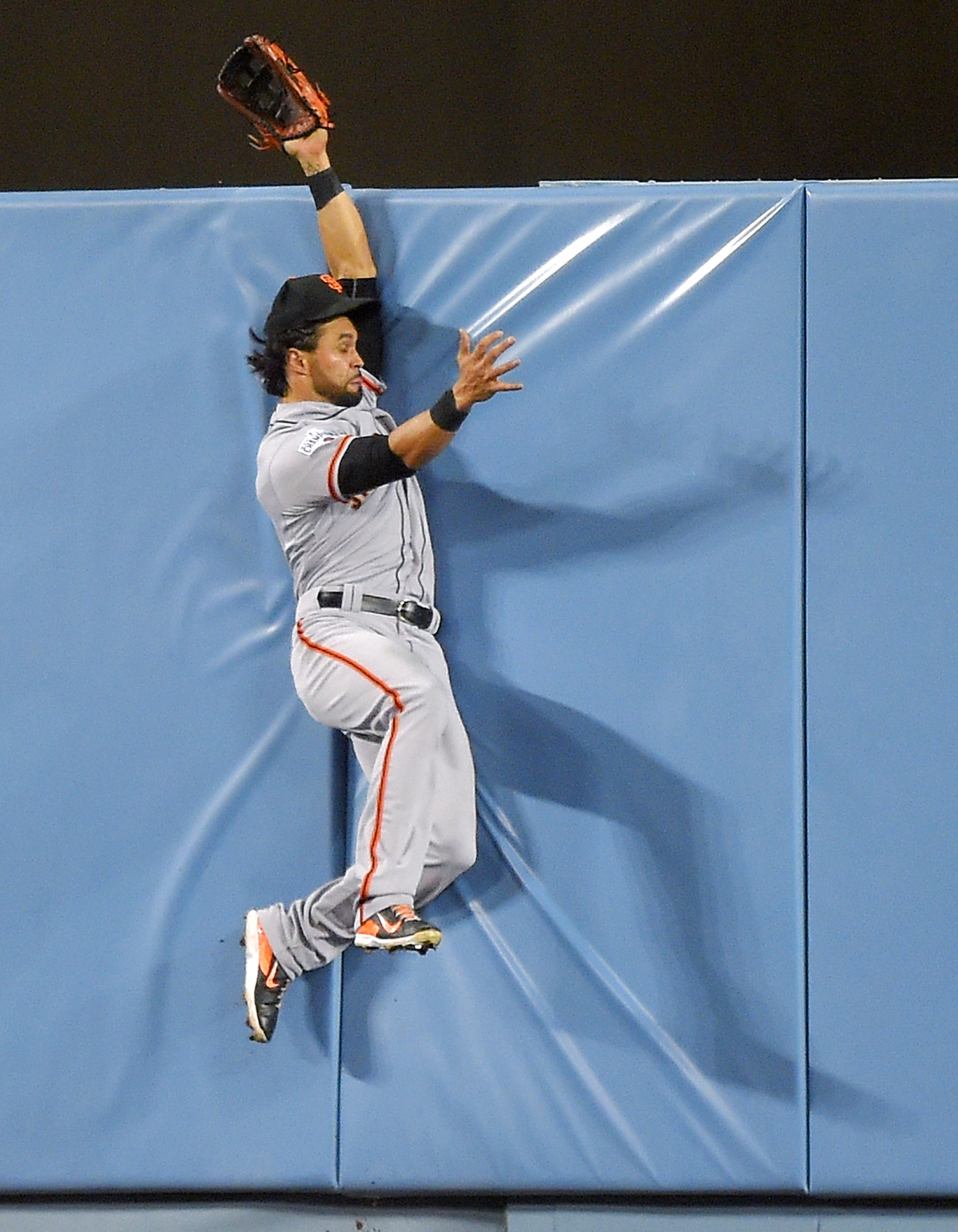 San Francisco Giants center fielder Angel Pagan can't reach a ball hit for a three-run home run by Los Angeles Dodgers' Justin Turner during the eighth inning of a baseball game, Monday, April 27, 2015, in Los Angeles. (AP Photo/Mark J. Terrill)