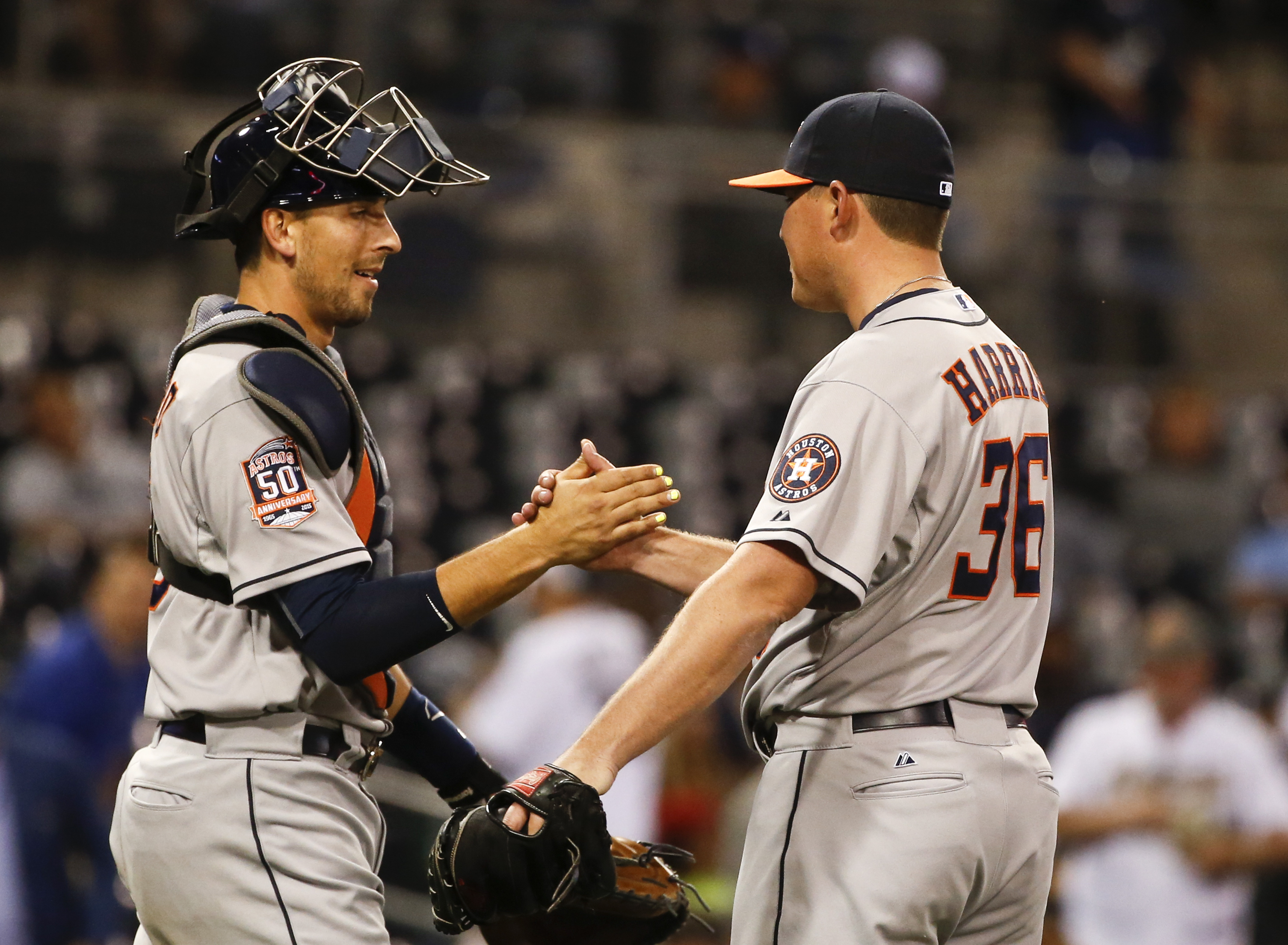 Houston Astros relief pitcher Will Harris and catcher Jason Castro congratulate each other after the Astros 9-4 victory over the San Diego Padres in a baseball game Monday, April 27, 2015 in San Diego.   (AP Photo/Lenny Ignelzi)