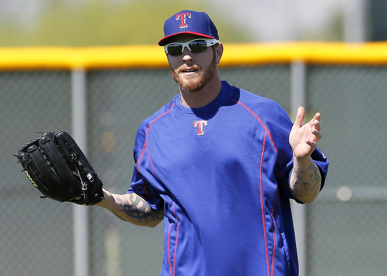 Texas Rangers baseball player Josh Hamilton works out at the Rangers' training facility, Tuesday, April 28, 2015, in Surprise, Ariz. (AP Photo/Matt York)