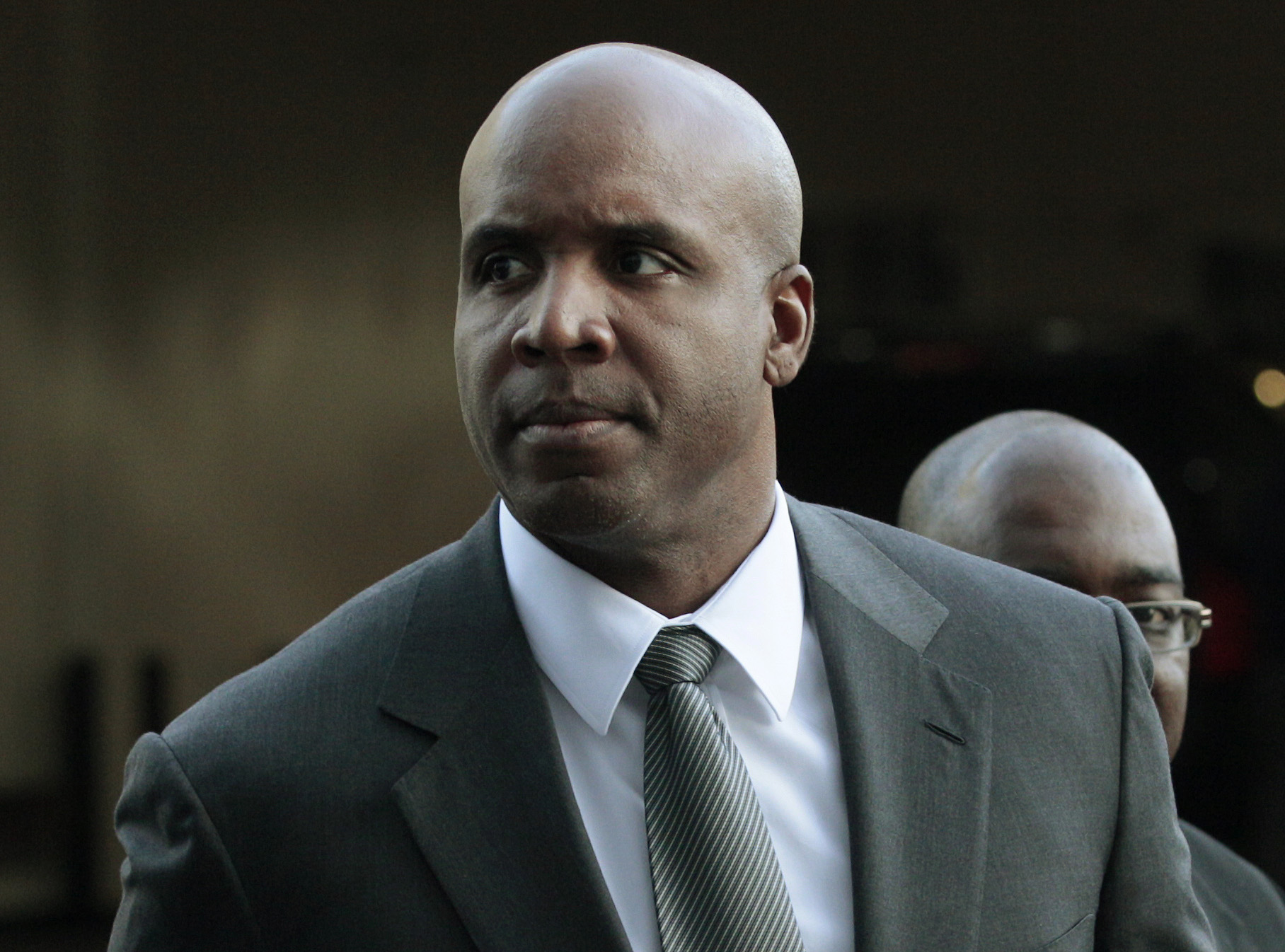 FILE - In ta March 29, 2011, file photo, former baseball player Barry Bonds arrives for his trial at federal court in San Francisco.  Federal prosecutors Tuesday April 28, 2015, are considering whether to ask the U.S. Supreme Court to reinstate Barry Bond