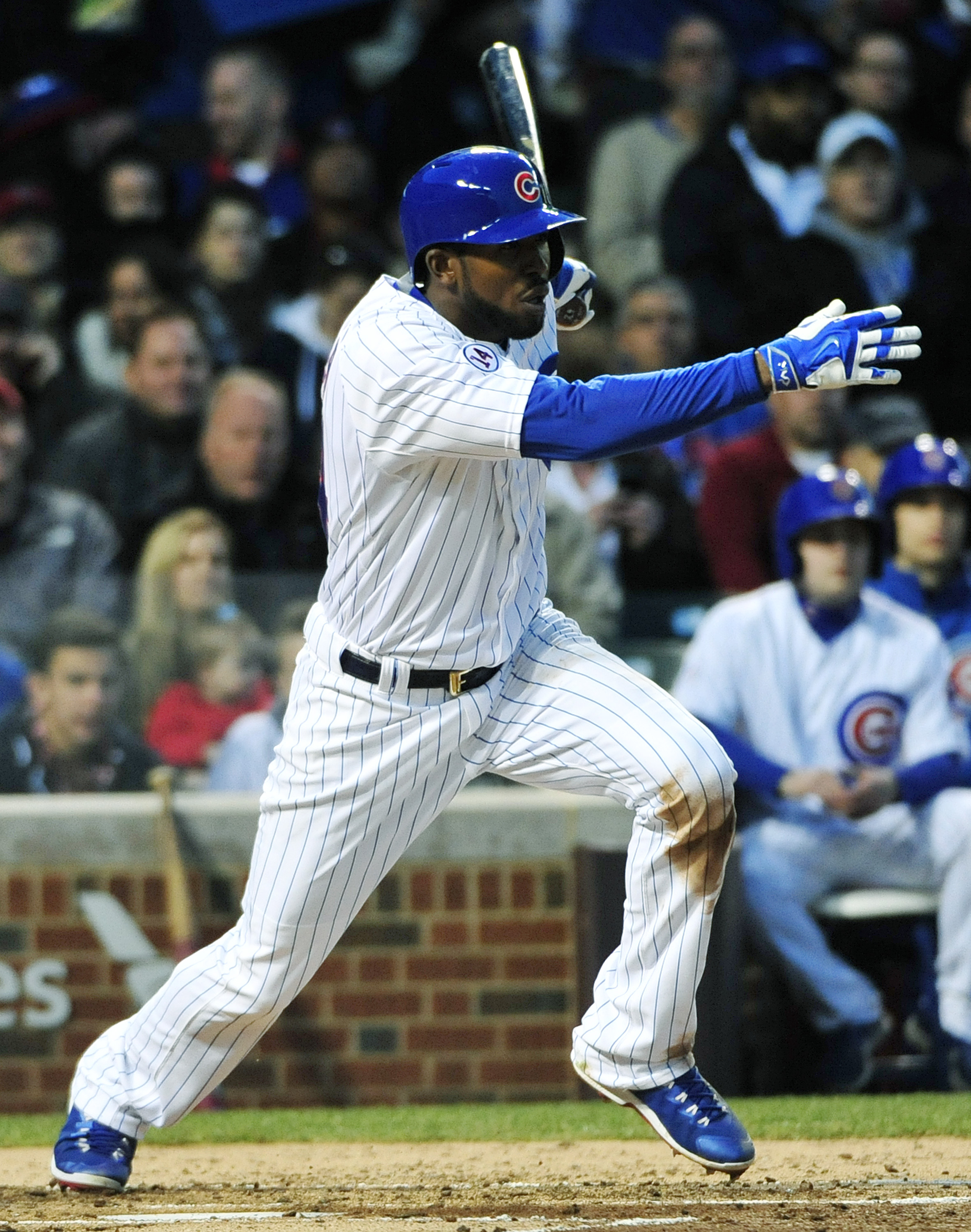Chicago Cubs' Dexter Fowler (24) hits a two RBI double against the Pittsburgh Pirates during the second inning of a baseball game, Tuesday, April 28, 2015 in Chicago. (AP Photo/David Banks)